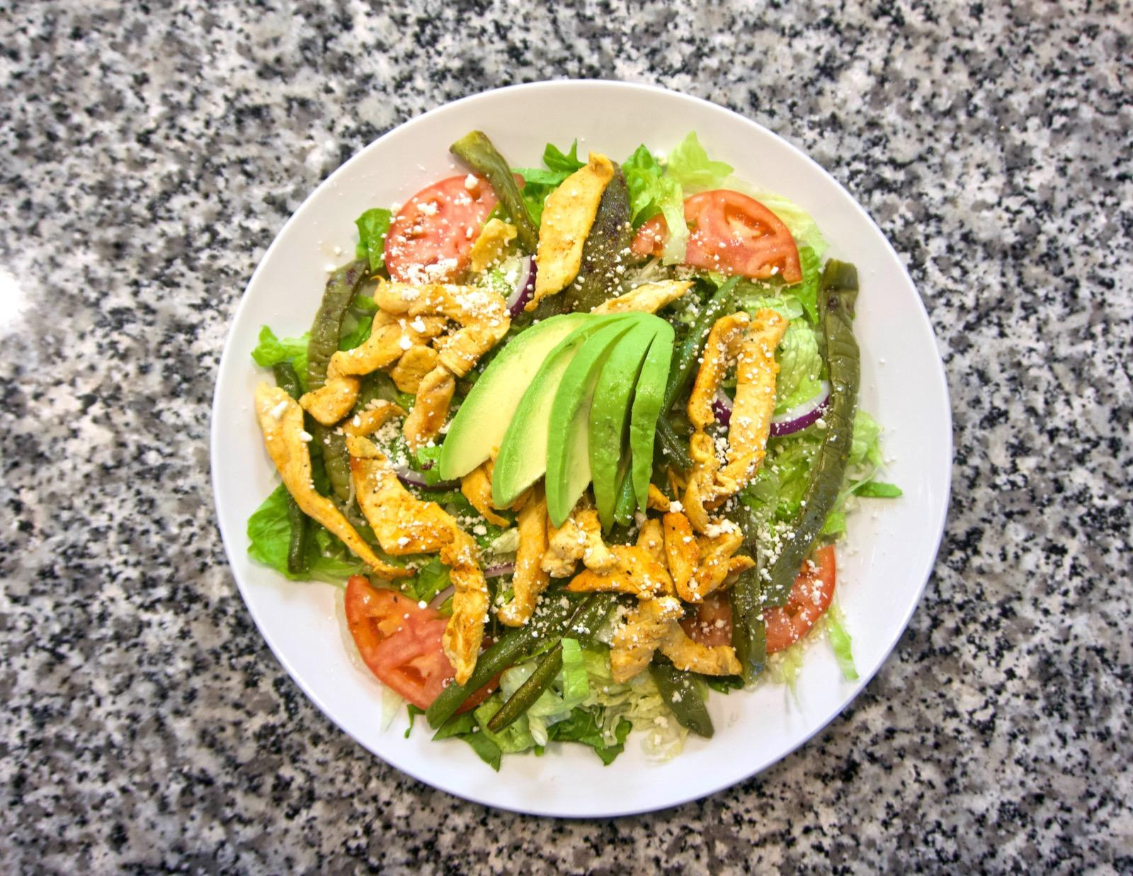 Veracruz salad: Spring mix salad and romaine lettuce with avocado, tomatoes, red onions, grilled shrimp, and cactus / Image: Brian Planalp // Published: 1.29.18