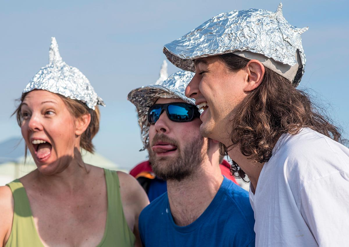 Carolyn Anderson, Will O'Neil, and Blake Zolezzi wear tin foil hats to represent their solar eclipse cult. Photo by Cheyenne Thorpe, Oregon News Lab