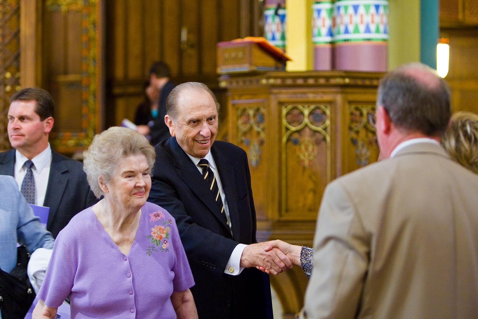 President Thomas S. Monson and his wife, Frances, greet visitors at the Cathedral of the Madeleine in August 2009. (Photo: MormonNewsroom.org)<p></p>