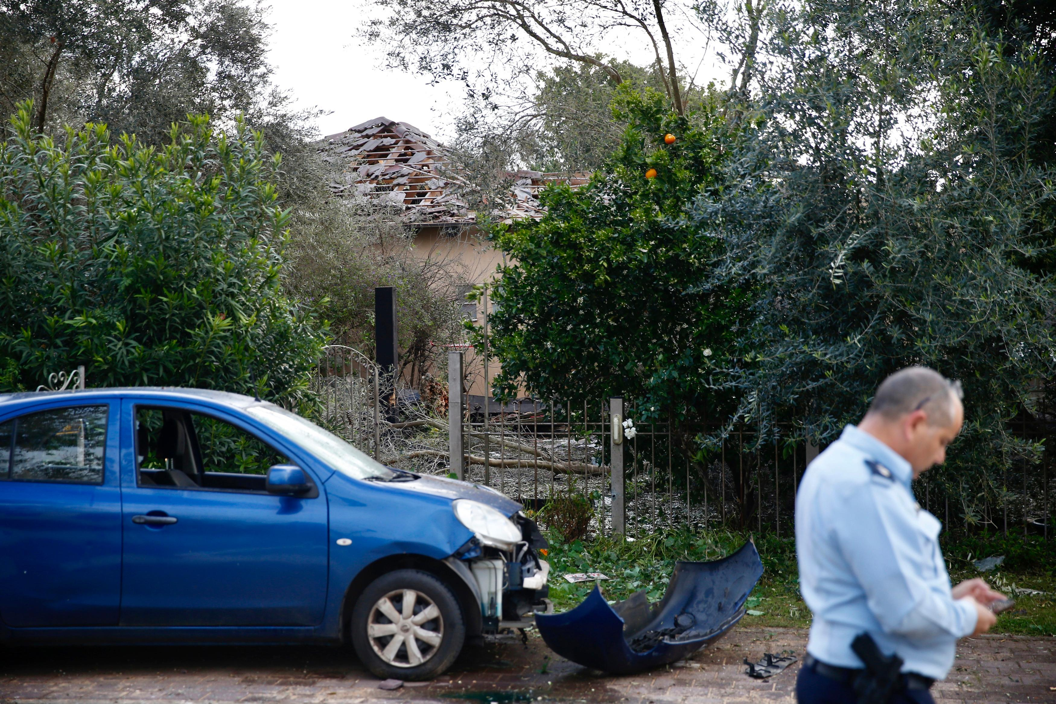 Damage to a house hit by a rocket is seen in Mishmeret, central Israel, Monday, March 25. (AP Photo/Ariel Schalit)