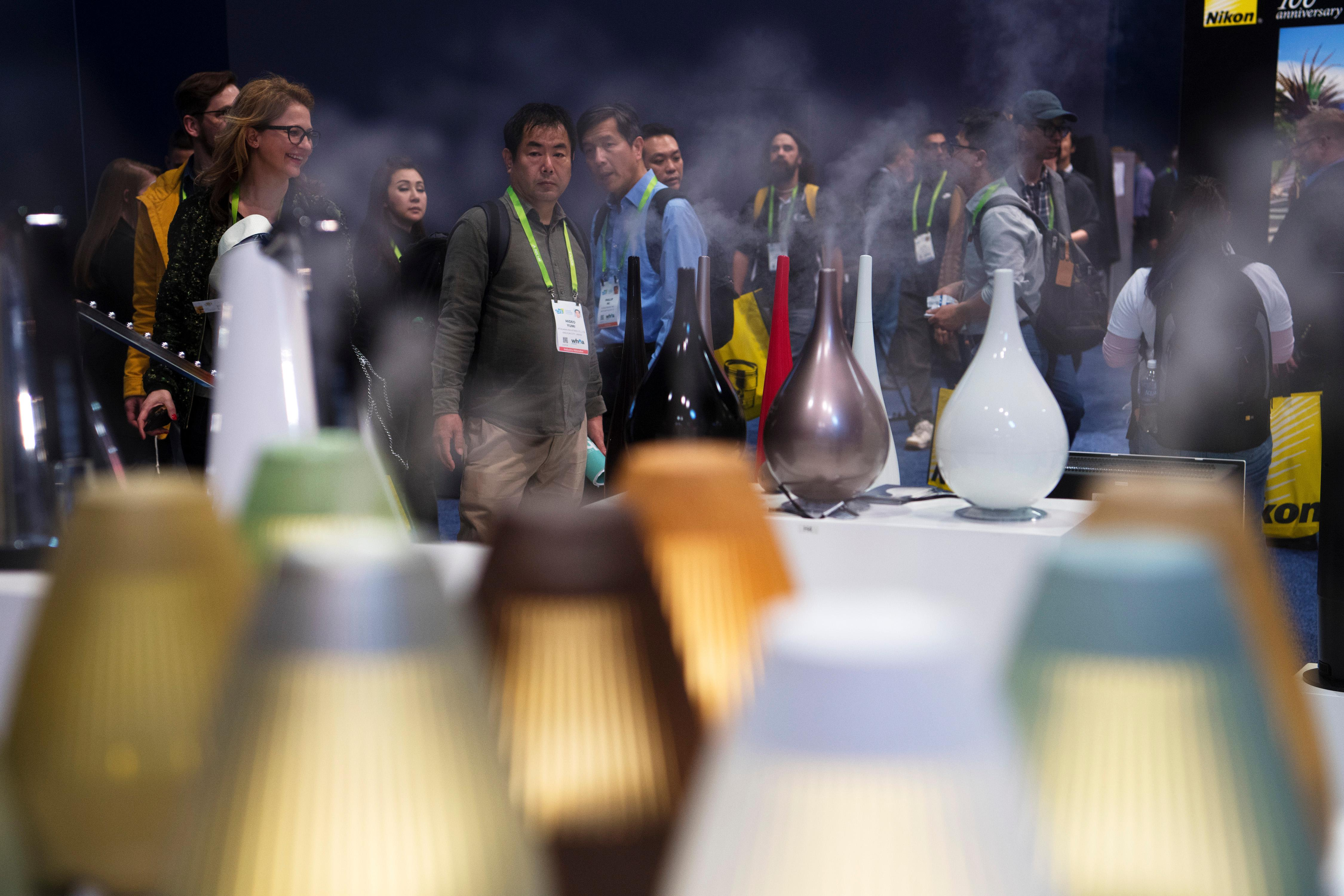 Attendees check out a line of diffusers during the second day of CES Wednesday, January 10, 2018, at the Las Vegas Convention Center. CREDIT: Sam Morris/Las Vegas News Bureau