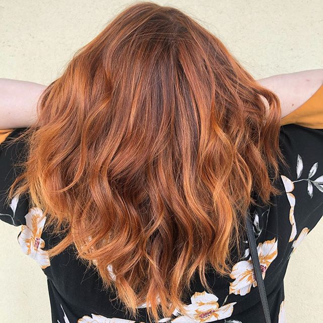 Warm Apricot Red: Red tones, ranging from strawberry to copper, are huge for summer. A natural-toned red base with apricot-colored highlights creates this soft look. This look, however, requires a bit more maintenance than highlights, due to the base color. The highlights need to be done about every 10 weeks and the base color needs to be done between 4 and 6 weeks depending on how quickly a client's hair grows. The client should ask for a warm red base with apricot or sherbet-toned highlights. (Image courtesy of Gene Juarez).