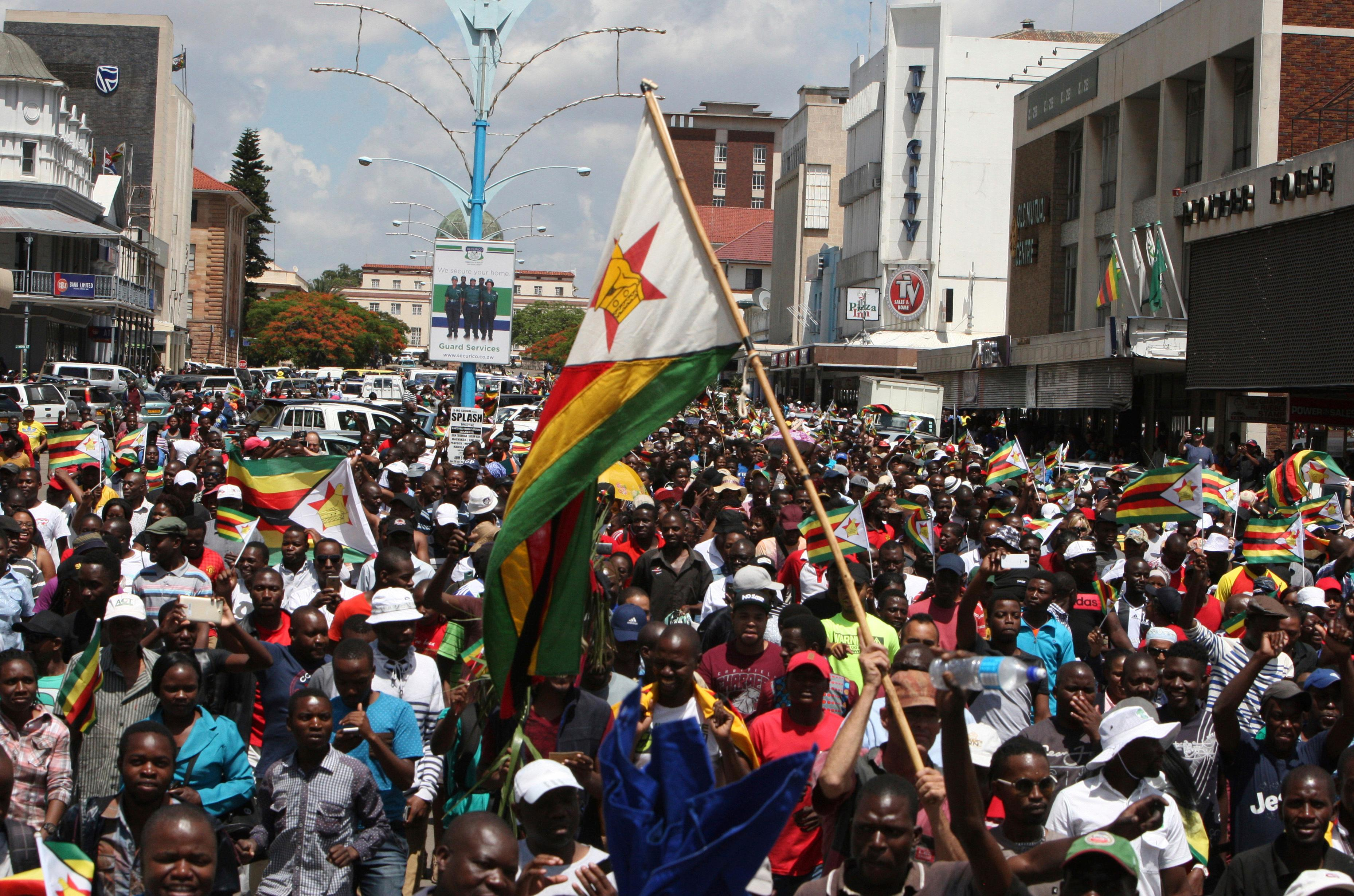 Hundreds gather in Bulawayo, Zimbabwe, Saturday, Nov. 18, 2017 to demand the departure of President Robert Mugabe after nearly four decades in power. (AP Photo/Lucky Tshuma)