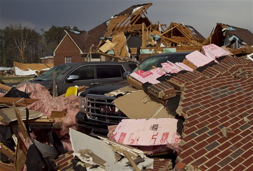 A tornado left a path of destruction as it passed through, Friday in Athens, Ala.