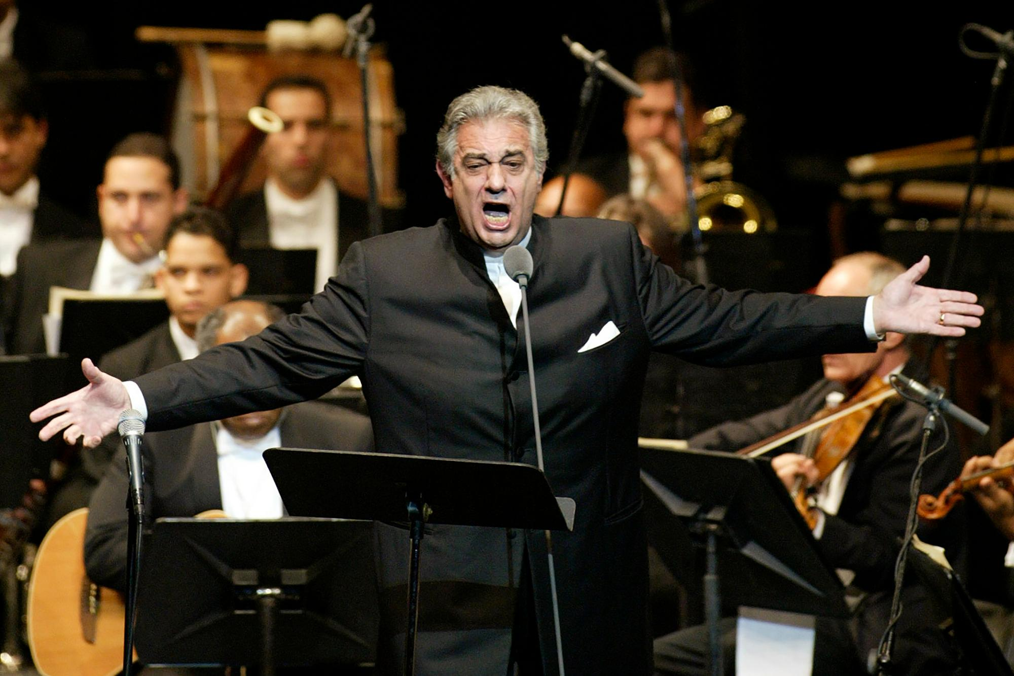 FILE - In this Jan. 22, 2004, file photo, Placido Domingo sings during his performance at the National Theater in Santiago, Dominican Republic.{ } (AP Photo/Miguel Gomez, File)