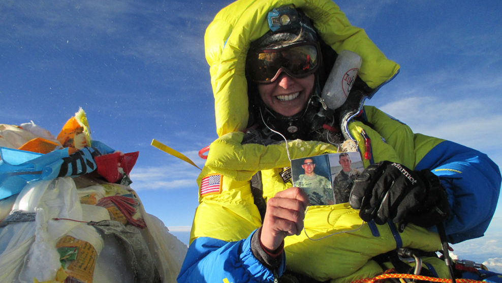 Army Capt. Elyse Ping Medvigy at the summit of Mount Everest with photos of PFC Keith Williams and Staff Sgt. Benjamin Prange. She was climbing in memory of the two , fallen soldiers.