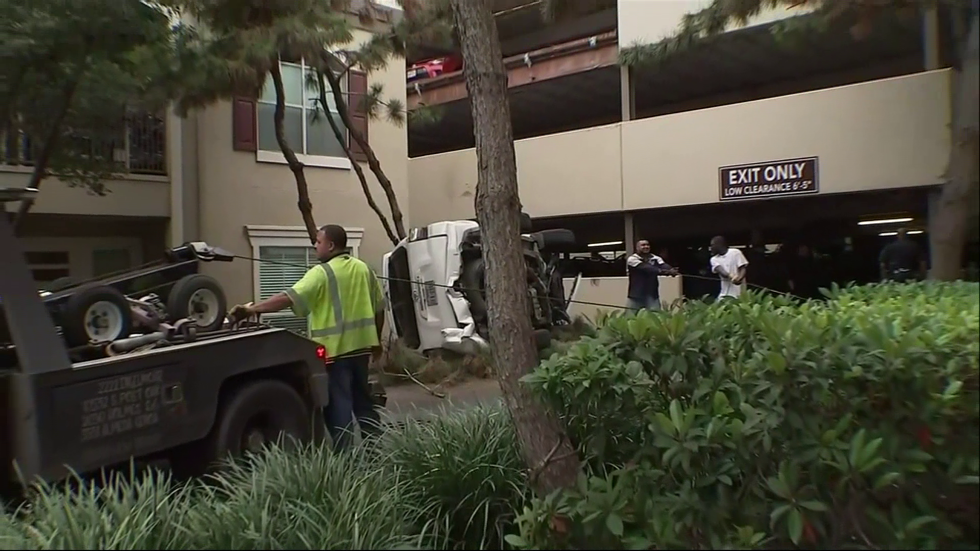 Authorities say an SUV has plunged from the third story of a Houston parking garage after the driver apparently accidentally hit the gas pedal instead of the brakes. (Image/video courtesy: KTRK / AP)
