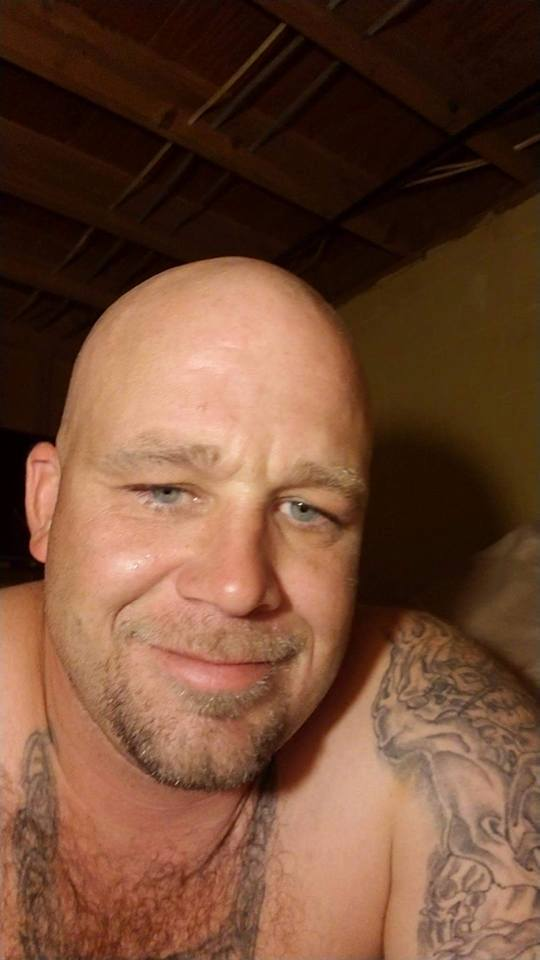 "Sean Sullivan is 5'10"" about 220lbs, shaved head, blue eyes, facial hair/goatee and ""sleeve"" tattoos on both arms."