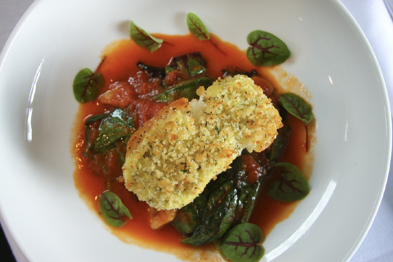 Seabass:  pan-roasted seabass, citrus aioli, herb breadcrumb, wilted local greens, and buttered tomato jus / Image: Molly Paz