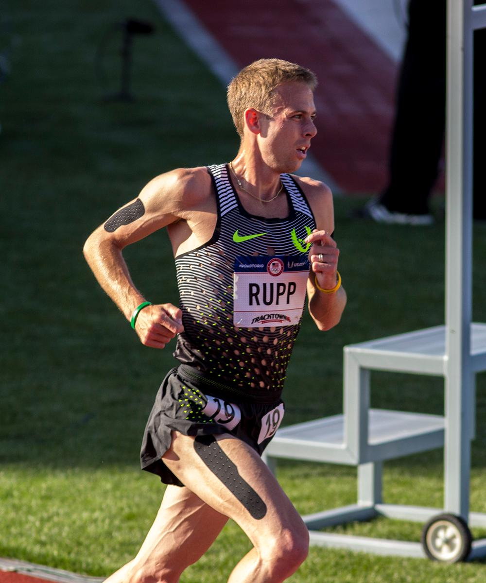Nike�s Galen Rupp rounds a corner for the Men�s 10,000 meter race. Rupp finished 1st overall with a time of 27:55.04. He also qualified for to compete in the marathon in the Olympics and he will compete in the 5,000m later in the trials. Day one of the U.S. Olympic Trials began on Friday at Hayward Field in Eugene, Ore. And will continue through July 10. (Photo by Amanda Butt)