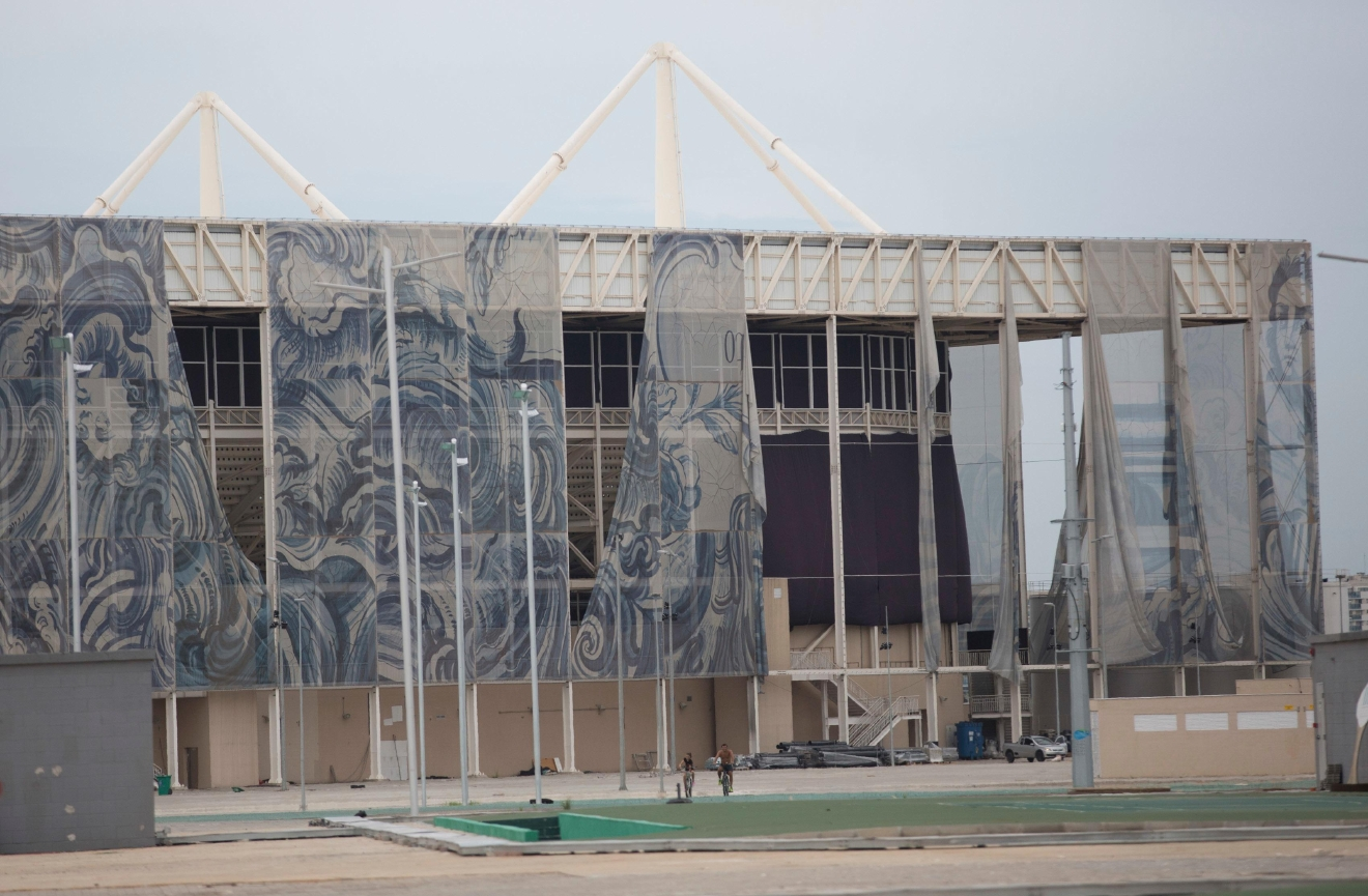 This Feb. 4, 2017 photo shows translucent tapestries created by Brazilian artist Adriana Varejao, falling from the exterior of Olympic Aquatic stadium inside Olympic Park in Rio de Janeiro, Brazil. The Olympic Park is a cutting-edge ghost town; sleek sports arenas without events, deserted before they were even broken in, and well-tended flower gardens, free from pedestrian wear-and-tear. (AP Photo/Silvia Izquierdo)