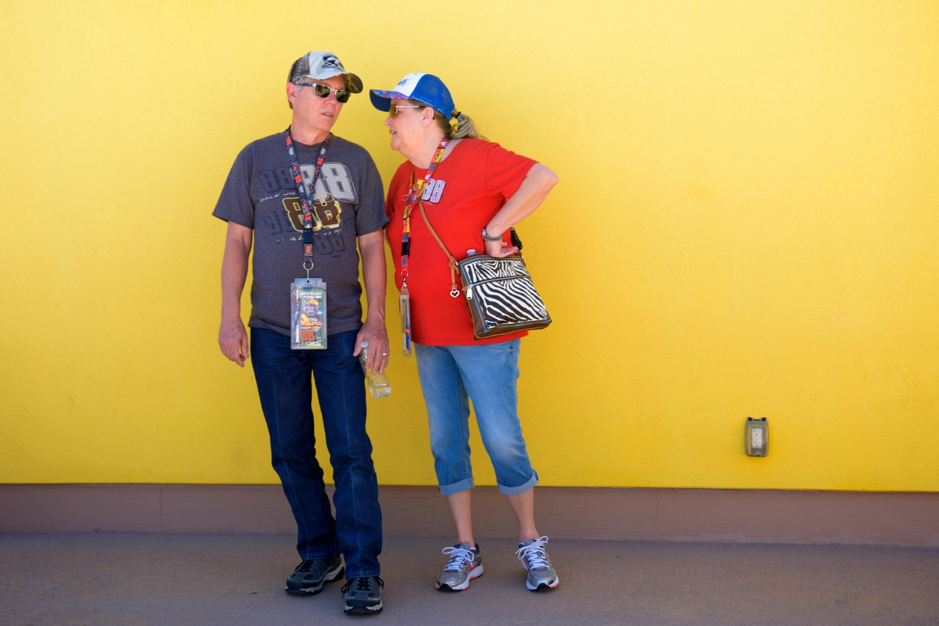 A couple stands against a yellow wall during the NASCAR Xfinity Series Boyd Gaming 300 Saturday, March 11, 2017, at the Las Vegas Motor Speedway. (Sam Morris/Las Vegas News Bureau)
