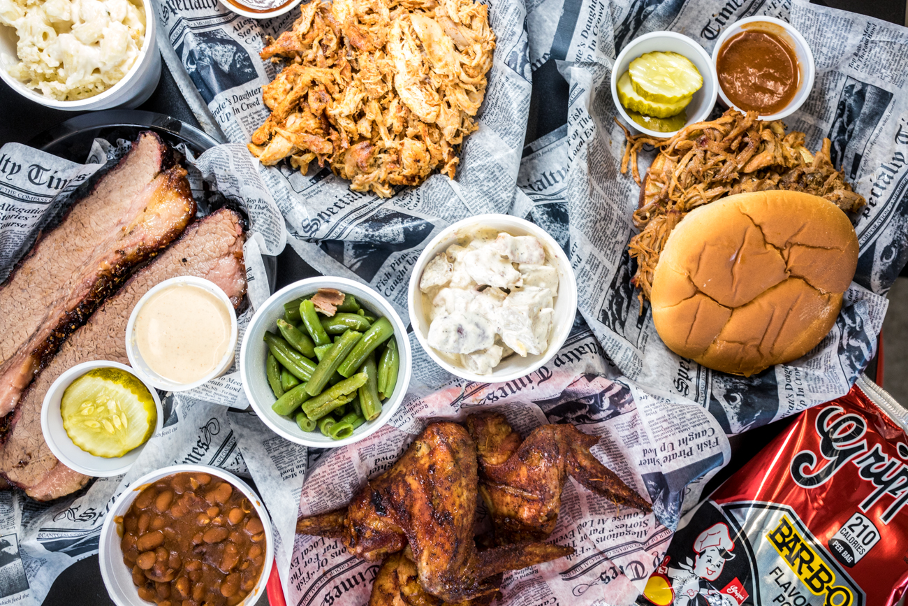 Brisket, smoked chicken, pulled pork, smoked wings, potato salad, green beans, baked beans, and mac and cheese with all the fixings{ }from Riverside BBQ / Image: Catherine Viox // Published: 8.28.20
