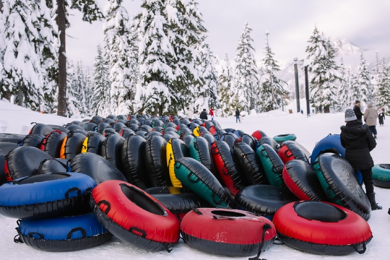 It's officially Tubing Season at the Summit at Snoqualmie! With more than a dozen groomed lanes, a covered conveyor belt to get you up the hill, inner tubes and everything you need, the Tubing Center is the perfect place to play in the snow. To learn more and buy tickets for your next trip go to http://www.summitatsnoqualmie.com/mountains/tubing. (Image: Joshua Lewis / Seattle Refined)<p></p>