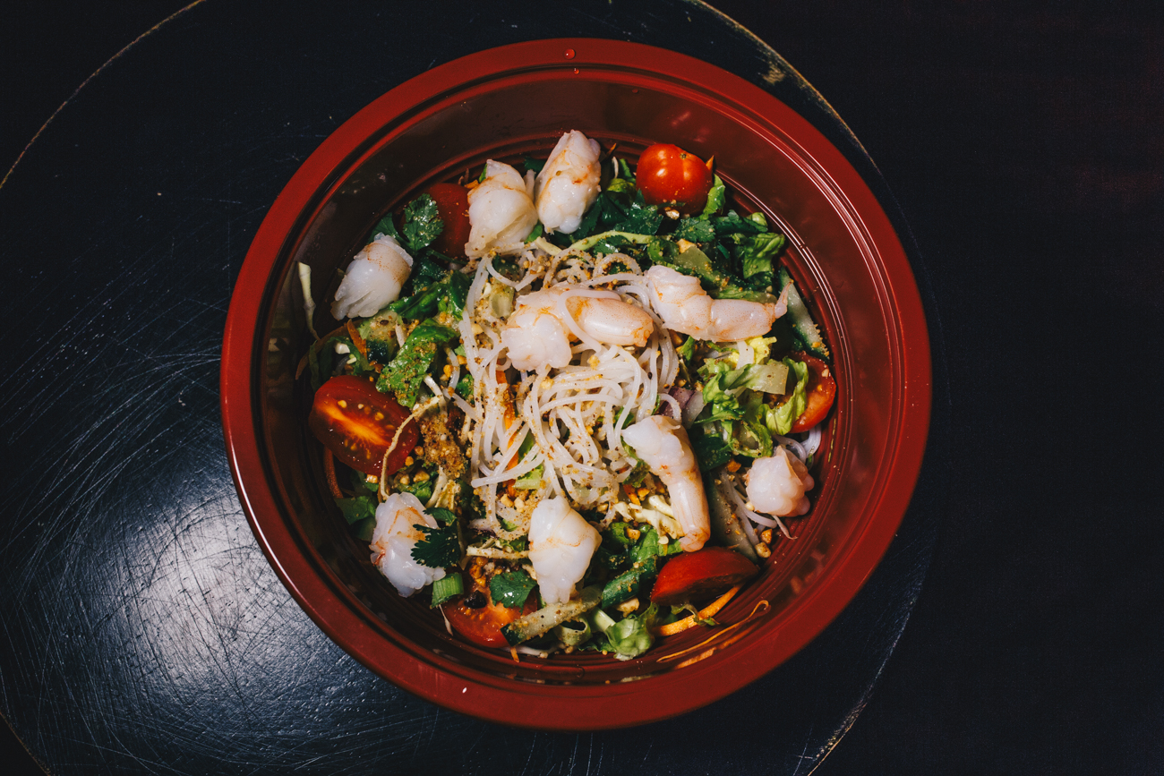 Cold noodle salad with shrimp: cabbage, carrots, cucumber, cilantro, roasted peanuts, tomatoes, vermicelli noodles, and Cambodian vinaigrette / Image: Catherine Viox // Published: 2.24.19