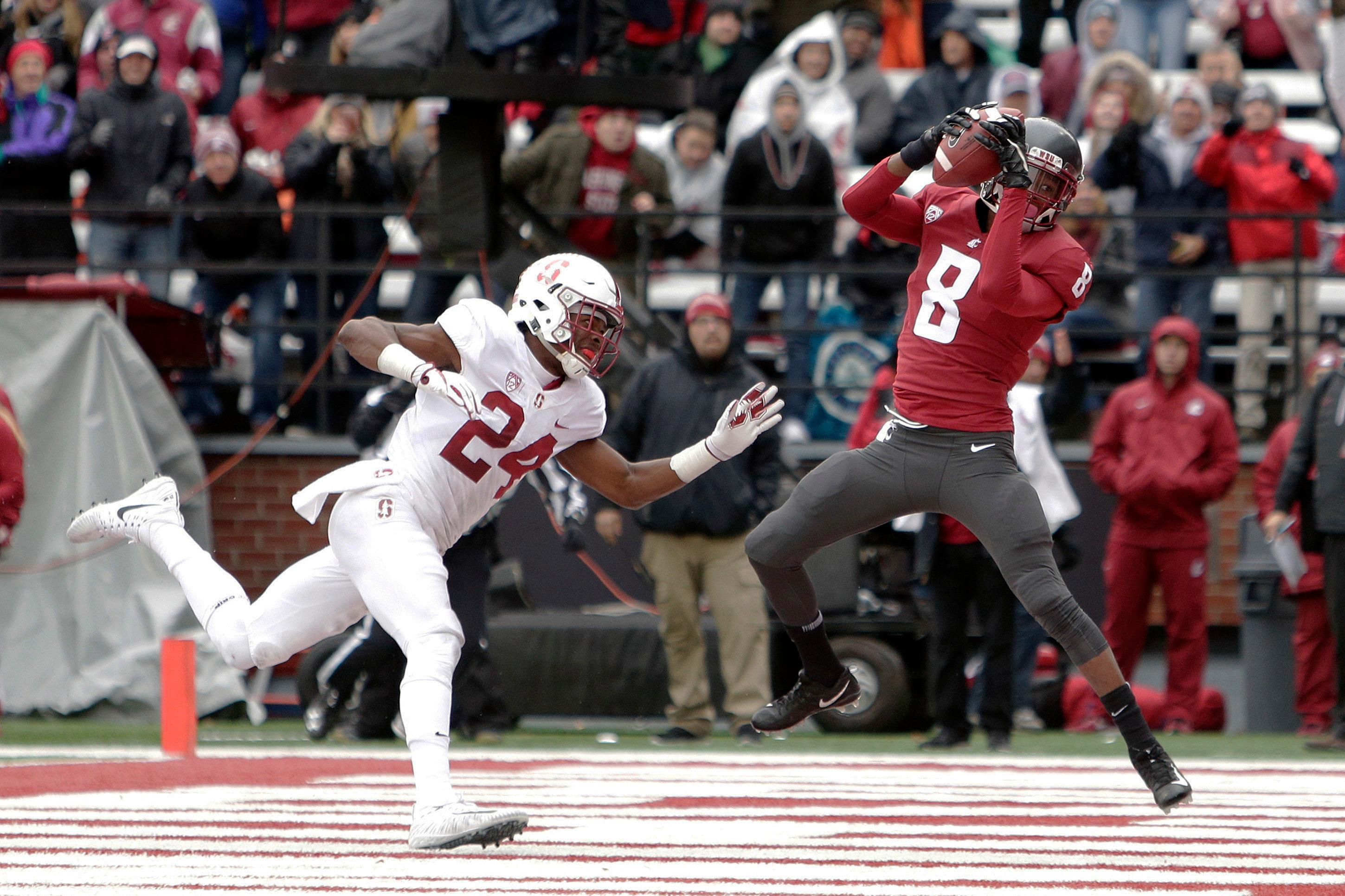 Washington State wide receiver Tavares Martin Jr. (8) catches a touchdown pass while defended by Stanford cornerback Quenton Meeks (24) during the first half of an NCAA college football game in Pullman, Wash., Saturday, Nov. 4, 2017. (AP Photo/Young Kwak)