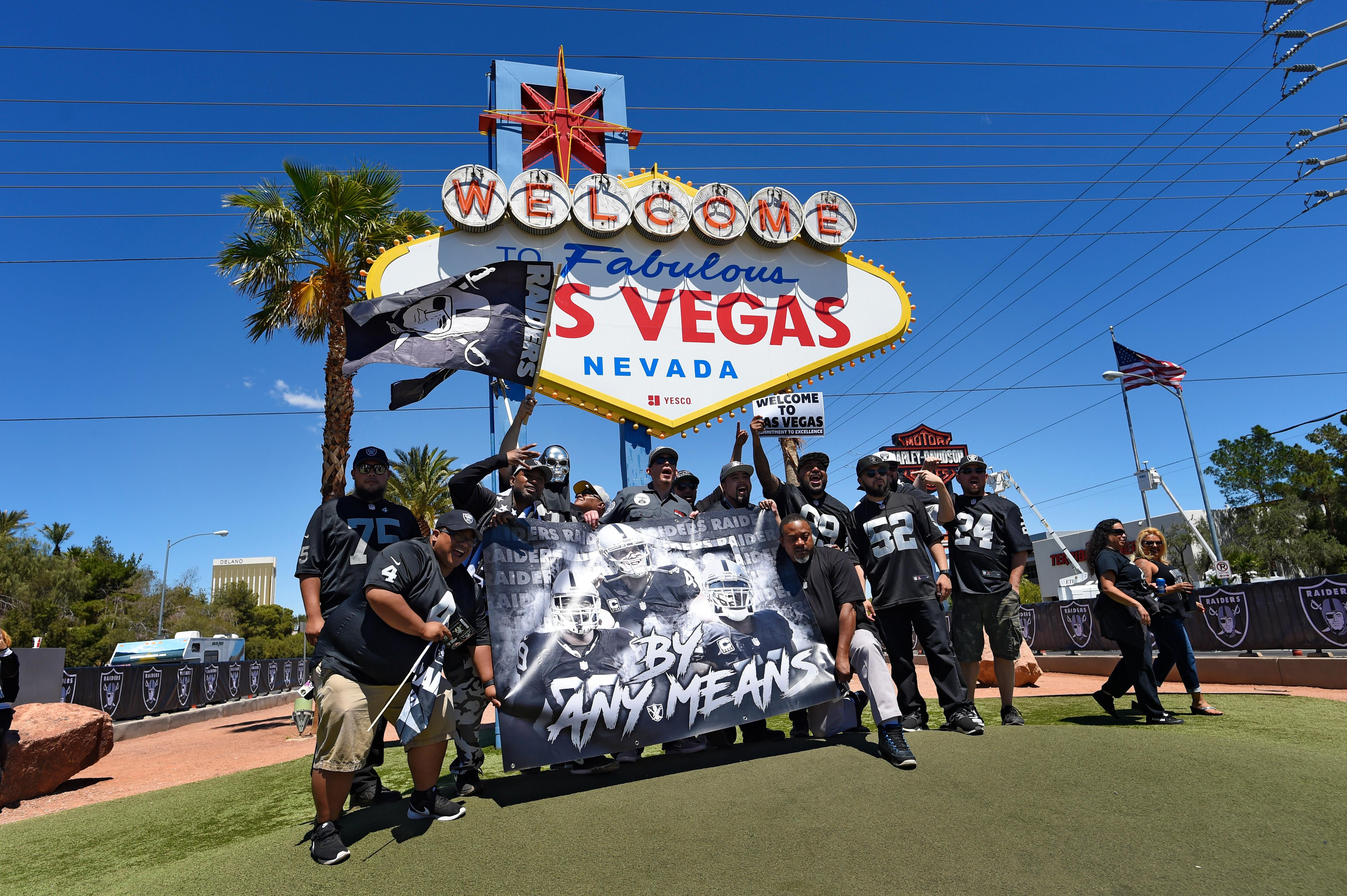 "Raiders fans pose for a photo as the Raiders fifth round draft pick is announced in front of the ""Welcome to Fabulous Las Vegas"" sign Saturday, April 28, 2017. [Sam Morris/Las Vegas News Bureau]"