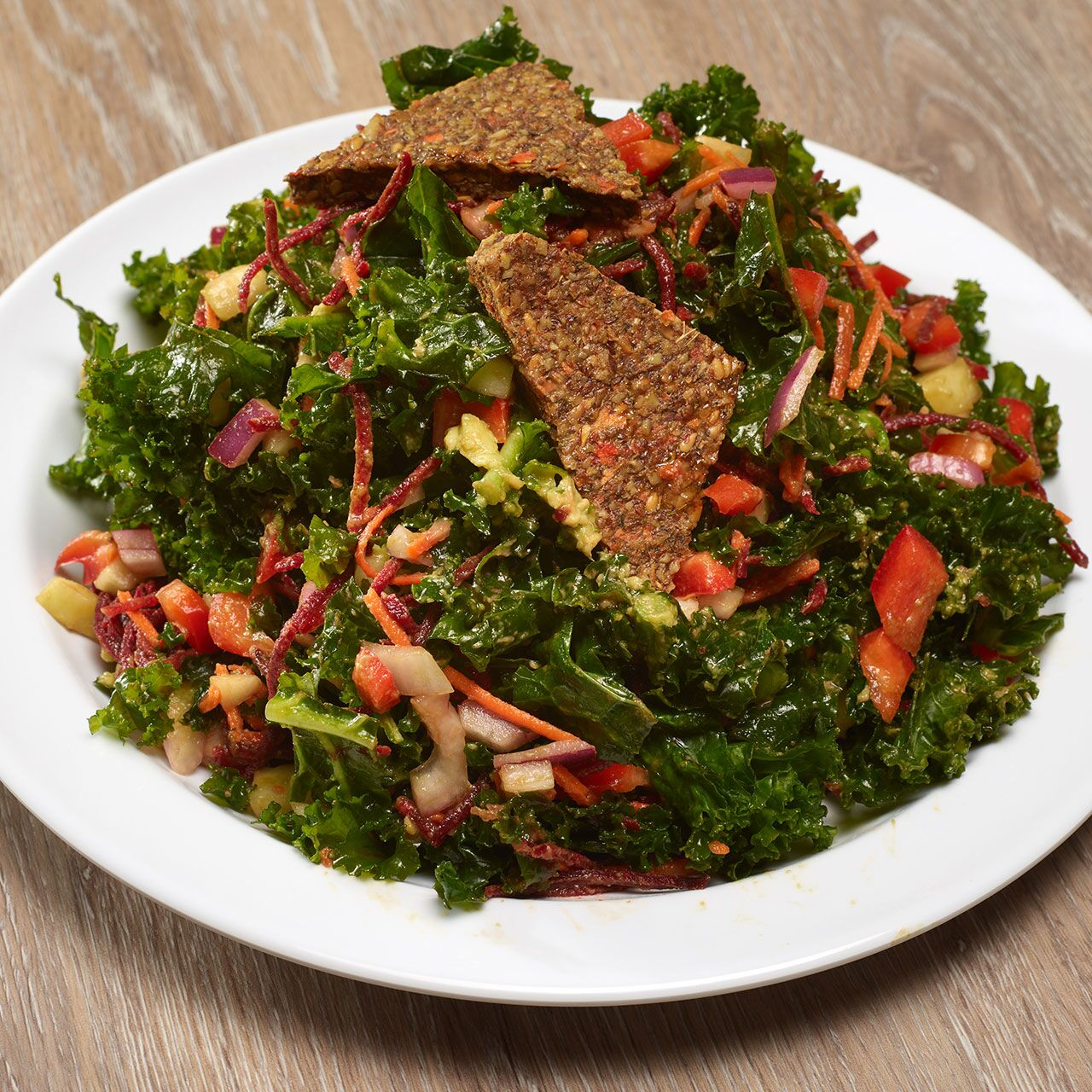 5.	Kale Salad from GRK Fresh Greek:{ }Kale, romaine, tomatoes, carrots, black eyed peas, Greek feta and lemon herb vinaigrette. (Image: Courtesy Grubhub)