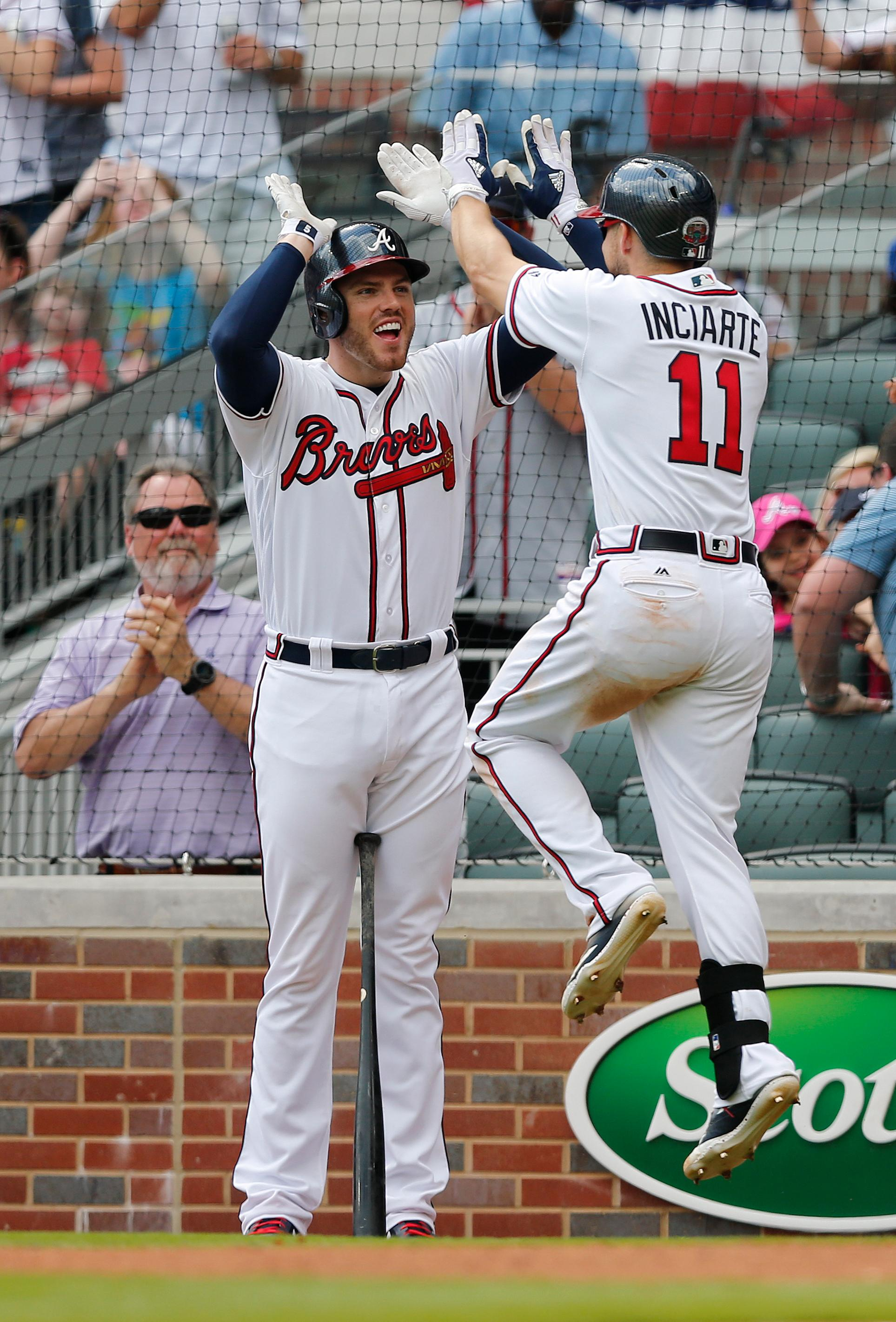 Atlanta Braves center fielder Ender Inciarte (11) celebrates with teammate Freddie Freeman after hitting a home run in the seventh inning of a baseball game against the San Diego Padres, Sunday, April 16, 2017, in Atlanta. Atlanta won 9-2. (AP Photo/John Bazemore)