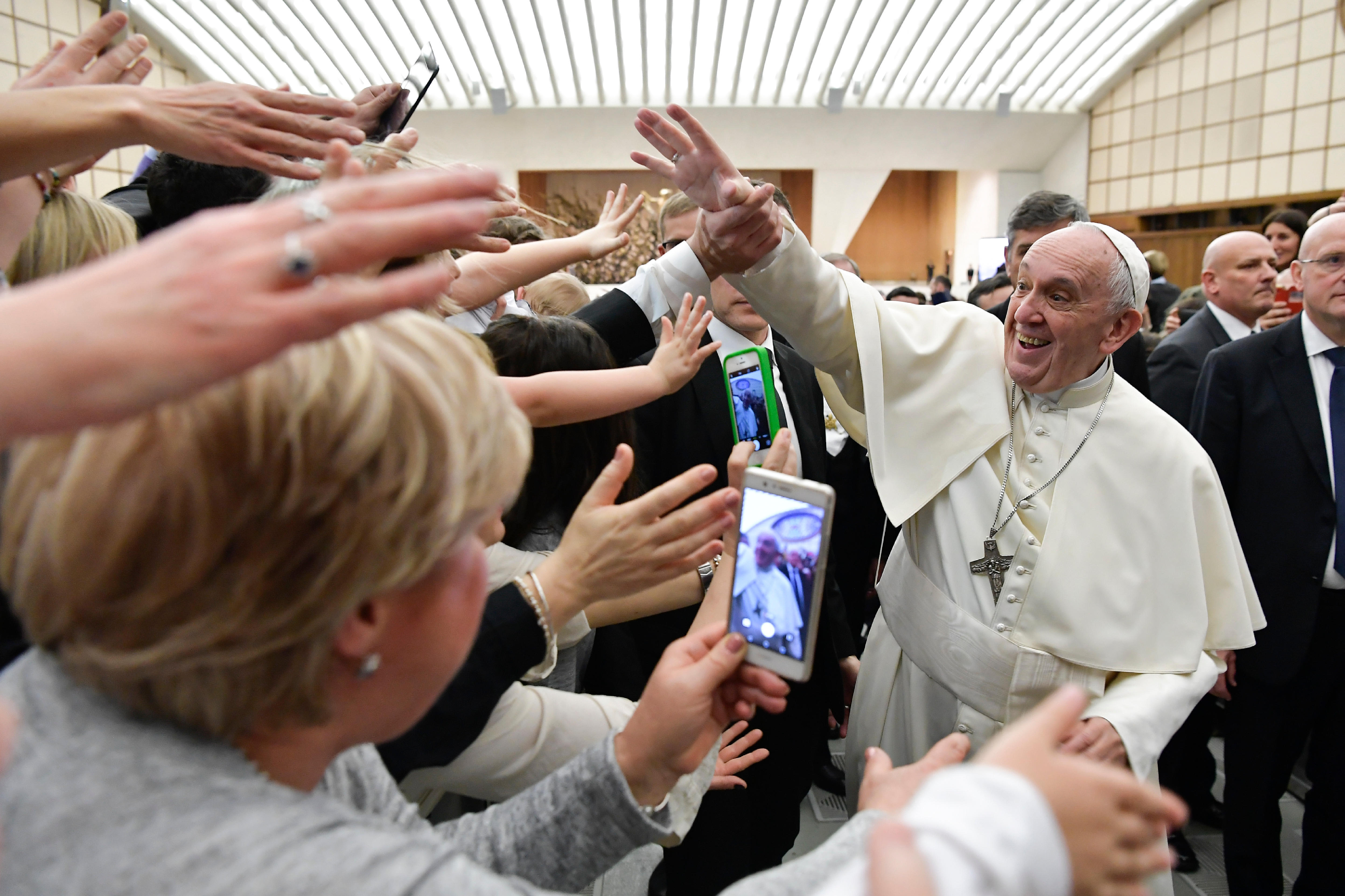 Pope Francis is cheered by faithful during an audience with health workers, in the Paul VI hall at the Vatican, Saturday, March 3, 2019. (L'Osservatore Romano/ANSA via AP)