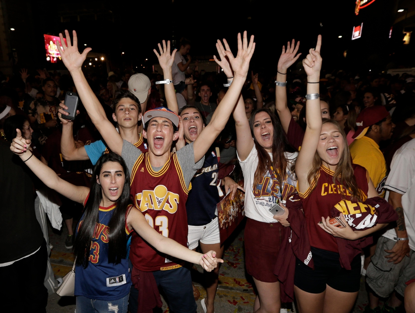 Cleveland Cavaliers fans celebrate after the Cavaliers defeated the Golden State Warriors 93-89 in Game 7 of the NBA basketball Finals, Sunday, June 19, 2016, in Cleveland. (AP Photo/Tony Dejak)