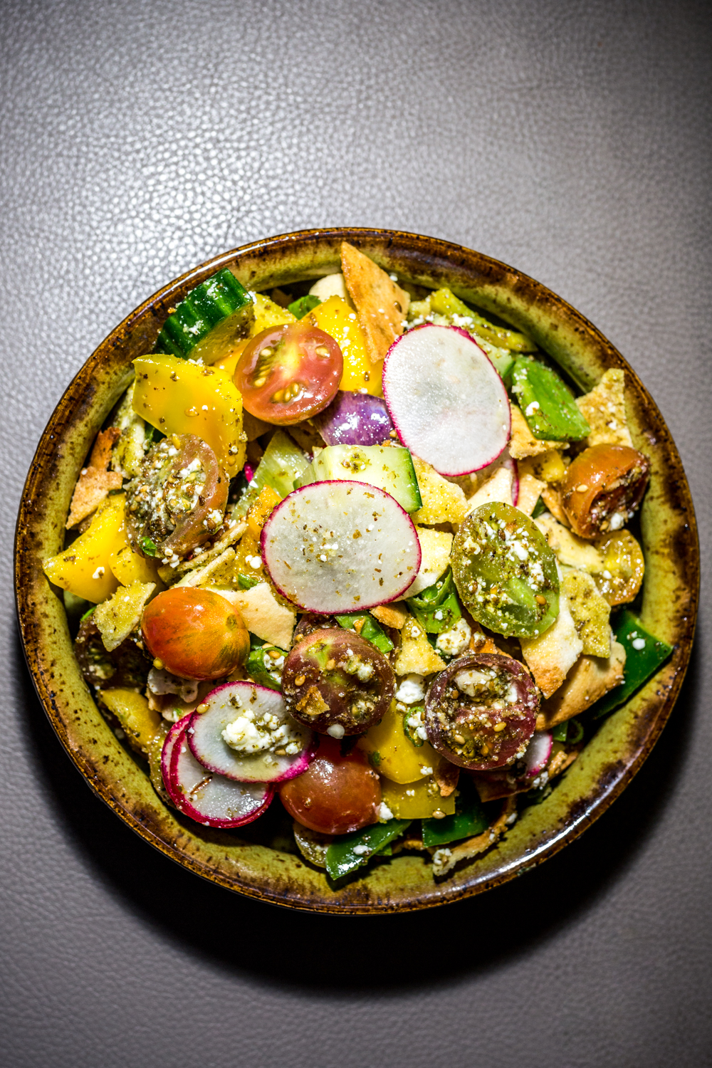 Fattoush 2.0: yellow peppers, radish, tomato, scallion, cucumber, za'atar, warm pita, cheese, and lemon / Image: Catherine Viox{ }// Published: 9.30.19