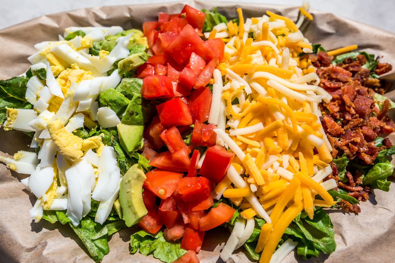 Coastline Cobb Salad from The Sandbar: romaine, avocado, tomato, hard-boiled egg, bacon, and cheese blend / Image: Catherine Viox // Published: 7.18.19