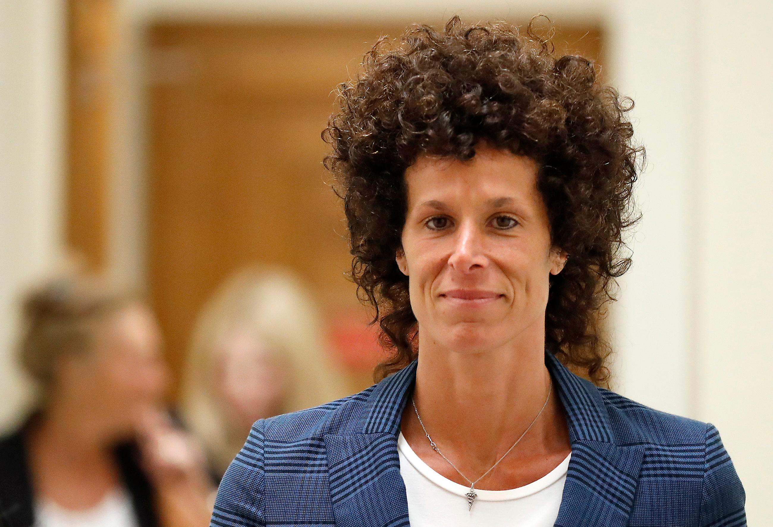 Andrea Constand leaves the courtroom after closing arguments in Bill Cosby's sexual assault trial at the Montgomery County Courthouse in Norristown, Pa., Monday, June 12, 2017. Cosby is accused of drugging and sexually assaulting Constand at his home outside Philadelphia in 2004. (David Maialetti/The Philadelphia Inquirer via AP, Pool)