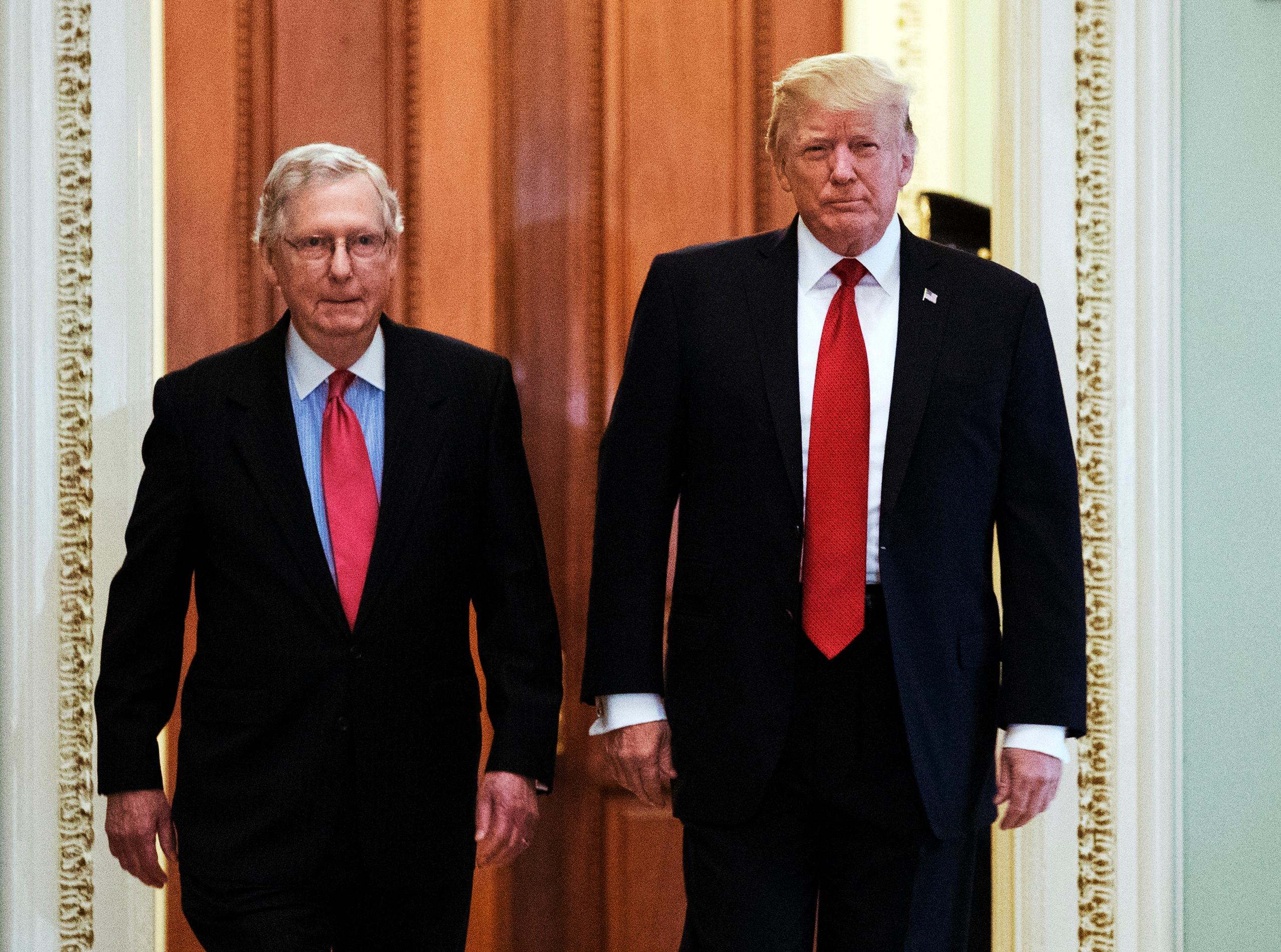 President Donald Trump, escorted by Senate Majority Leader Mitch McConnell, R-Ky., arrives on Capitol Hill to have lunch with Senate Republicans and push for his tax reform agenda, in Washington, Tuesday, Oct. 24, 2017.  (AP Photo/Manuel Balce Ceneta)