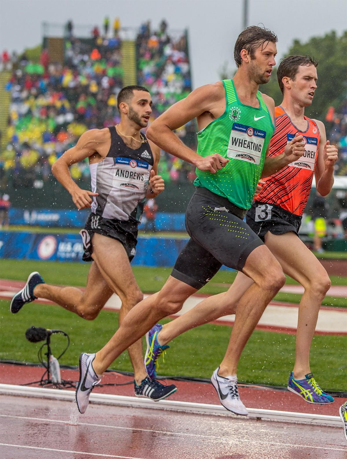 Nike OTC's Andrew Wheating races the 1,500 amidst a downpour. Wheating finished sixth overall with a time of 3:44.73 and qualified for the finals. Photo by August Frank, Oregon News Lab
