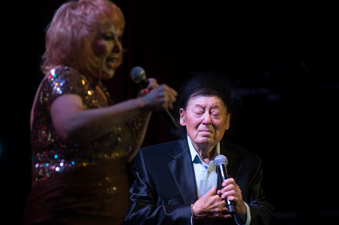 "Comedian Marty Allen is overcome with emotion as his wife Karon Kate Blackwell sings ""I'm Proud To Be An American"" during his 95th birthday show at the South Point Thursday, March 23, 2017. [Sam Morris/Las Vegas News Bureau]"