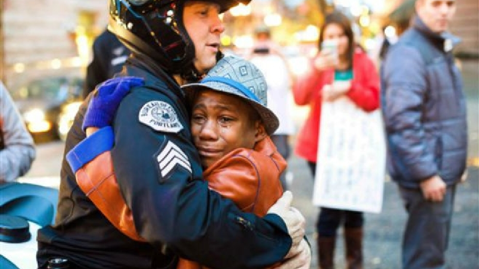 Devonte Hart is seen hugging an officer in a viral photo by Johnny Nguyen
