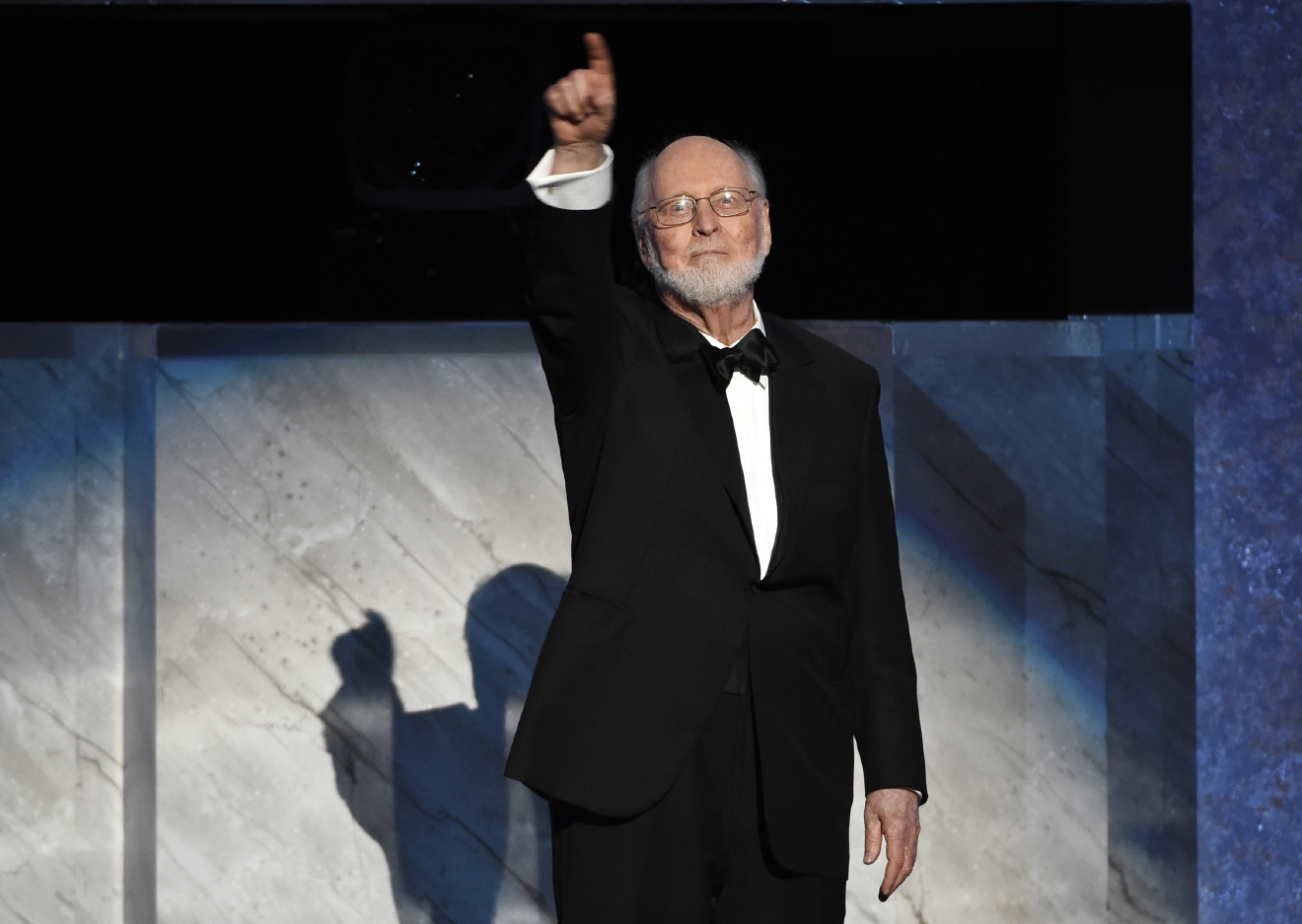 Composer John Williams gestures to the audience during the 2016 AFI Life Achievement Award Gala Tribute to Williams at the Dolby Theatre on Thursday, June 9, 2016, in Los Angeles. (Photo by Chris Pizzello/Invision/AP)