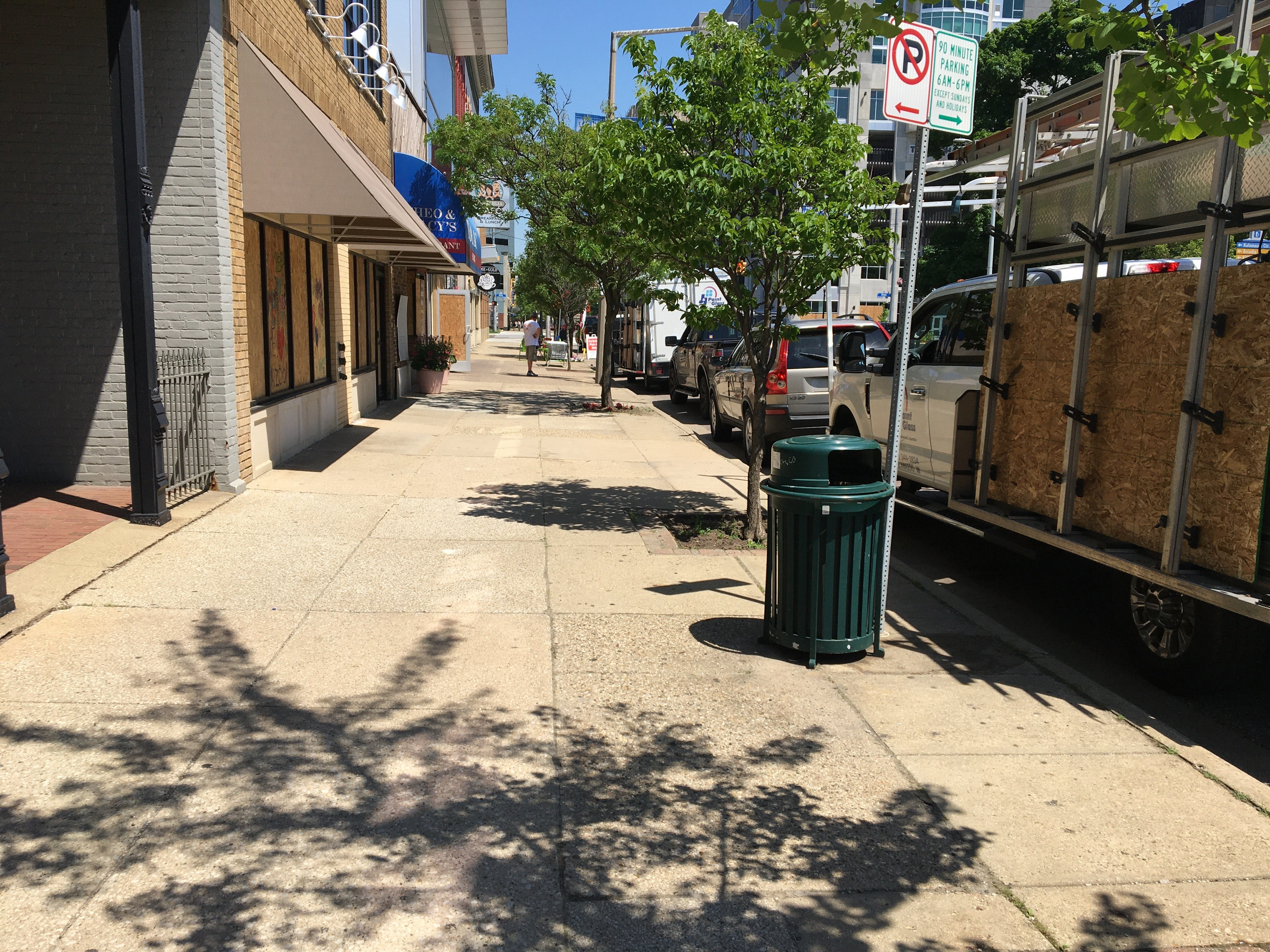 Downtown Kalamazoo businesses begin boarding up windows and doors Tuesday, June 2, 2020, after the city declared it will enforce a curfew starting at 7 p.m. (WWMT/Manny Revilla)