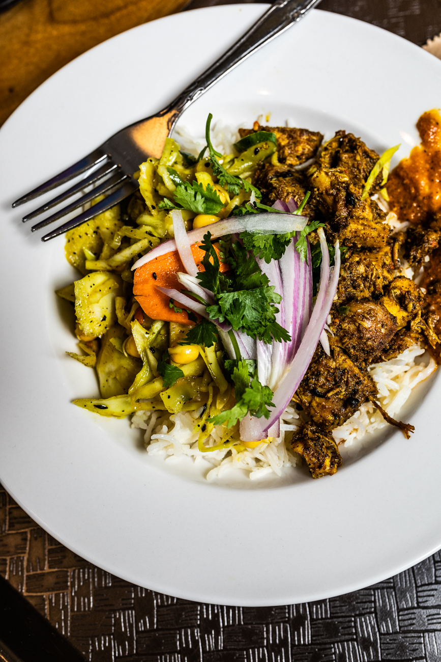 Chicken Tikki Masala Rice Bowl: grilled chicken simmered in a light tomato cream curry sauce with basmati rice and yellow lentils / Image: Amy Elisabeth Spasoff // Published: 8.22.19
