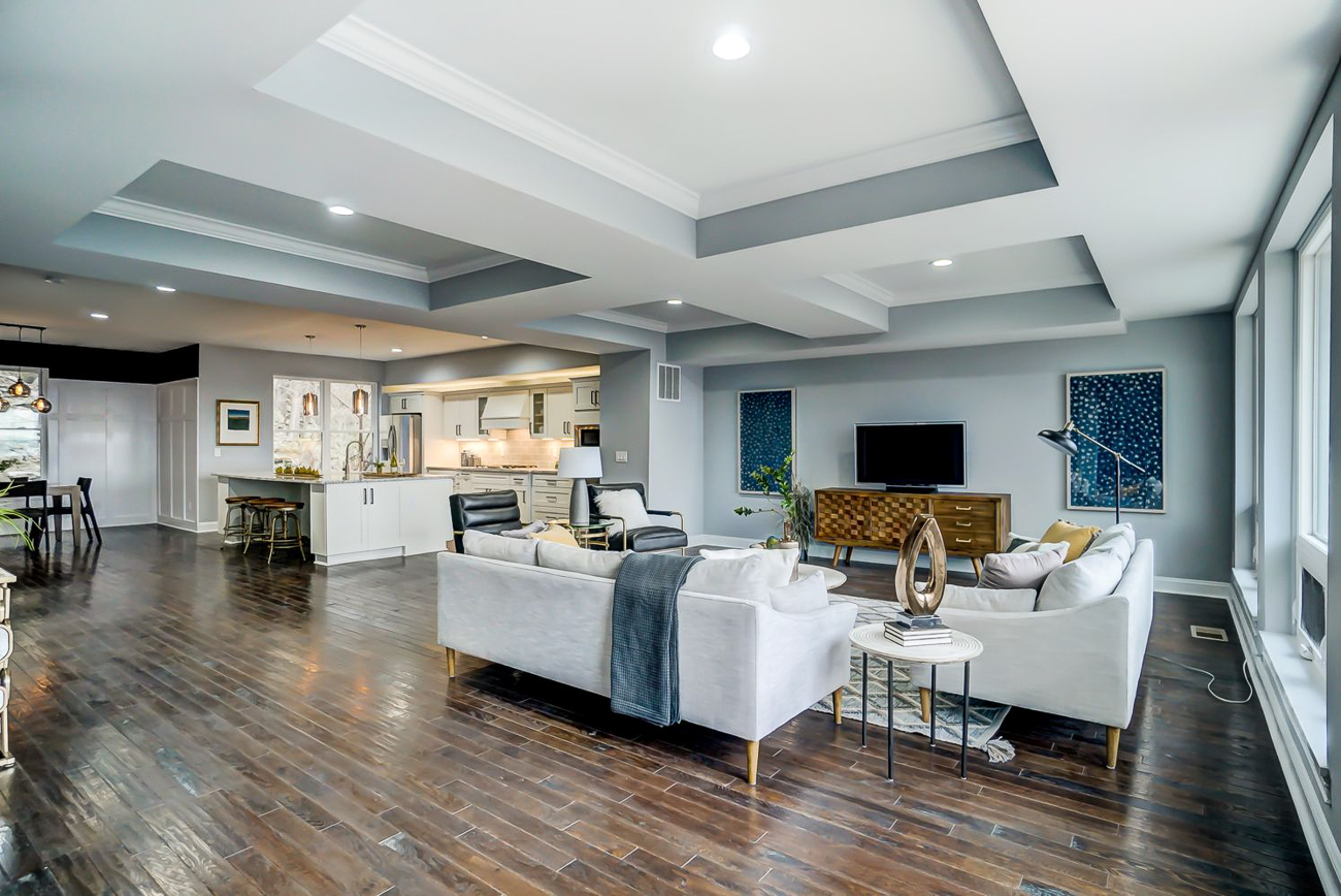 The gourmet kitchen and living room with a view share an open floor plan that seamlessly blends the two important spaces together. / Image courtesy of Kelly Gibbs, Coldwell Banker // Published: 12.28.18