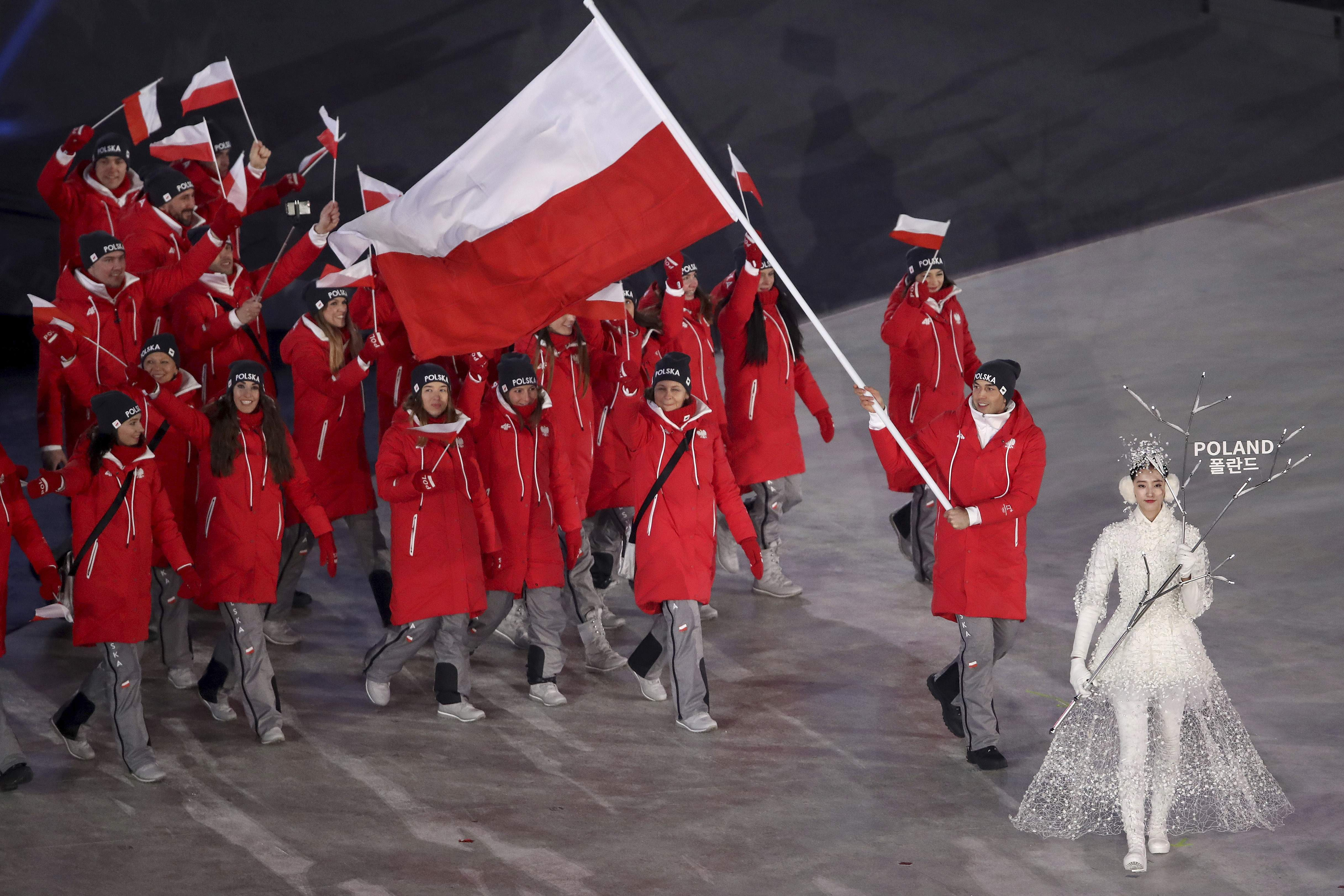 Kequyen Lam carries the flag of Poland during the opening ceremony of the 2018 Winter Olympics in Pyeongchang, South Korea, Friday, Feb. 9, 2018. (Sean Haffey/Pool Photo via AP)
