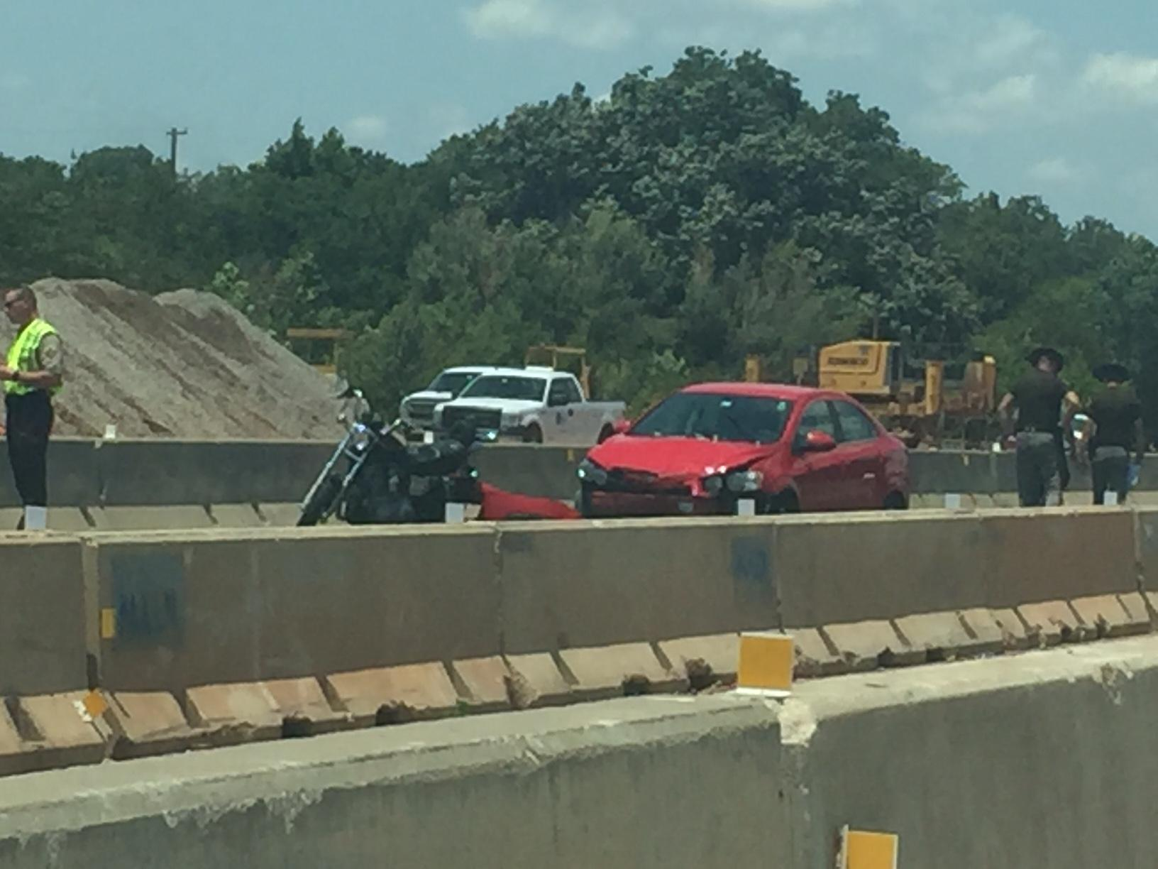 Police investigate a fatal crash June 29 in the southbound lanes of I-235 near 50 Street. (KOKH/Scott Noland)
