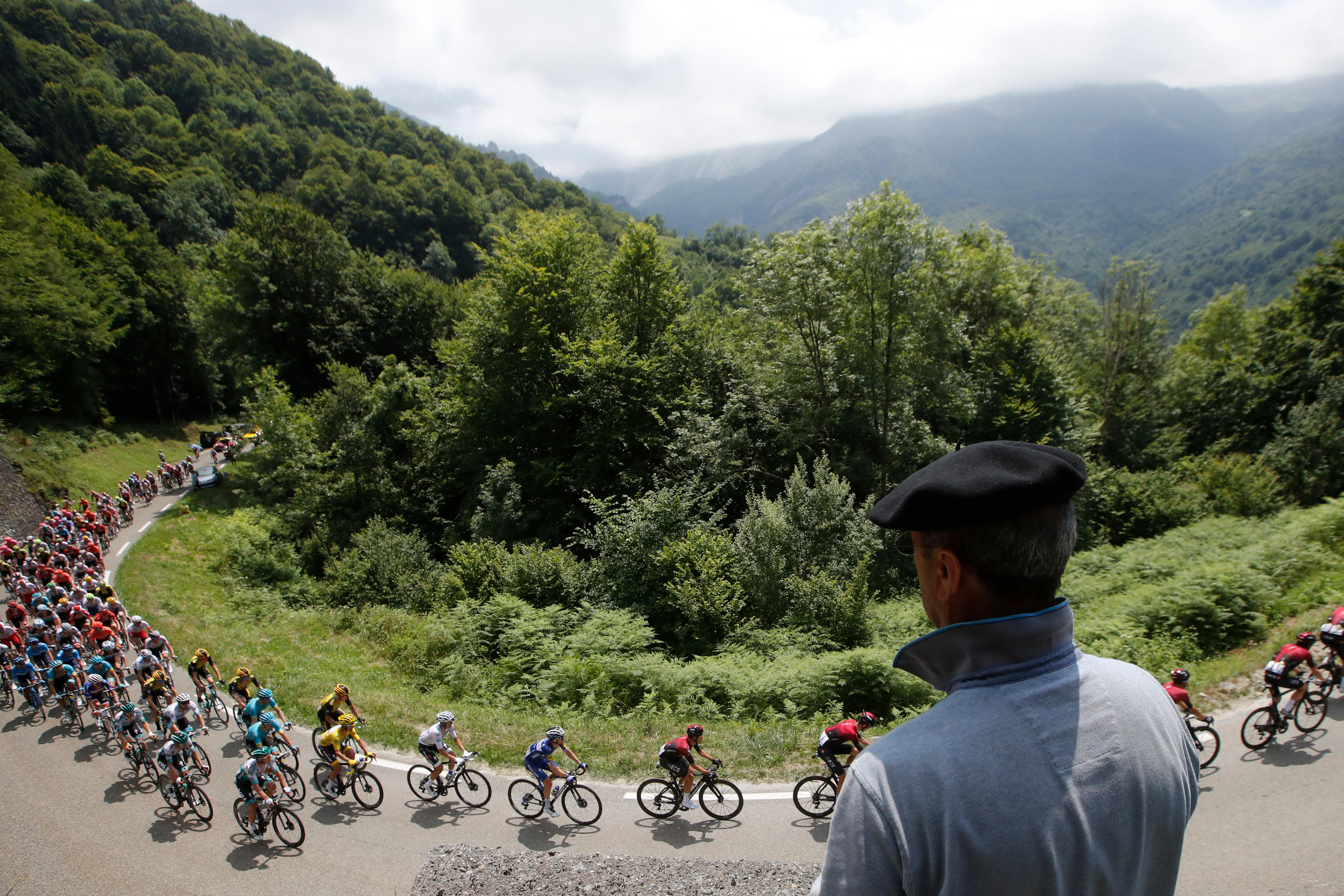 FILE - In this Saturday, July 20, 2019 file photo France's Julian Alaphilippe wearing the overall leader's yellow jersey rides with the pack during the fourteenth stage of the Tour de France cycling race over 117,5 kilometers (73 miles) with start in Tarbes and finish at the Tourmalet pass, France. (AP Photo/ Christophe Ena, File)