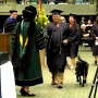 Veteran graduates college with service dog by his side
