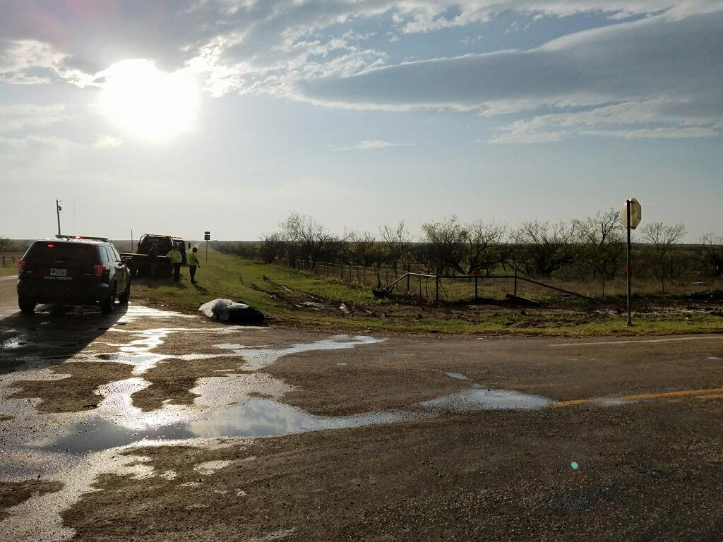 Texas Department of Public Safety troopers investigate a two-vehicle crash that left several storm chasers dead Tuesday, March 28, 2017, near Spur, Texas. The storms spawned multiple funnel clouds and an occasional tornado in open areas of West Texas on Tuesday afternoon. The crash happened at a remote intersection near the town of Spur, about 55 miles southeast of Lubbock. (Ellysa Gonzalez/Lubbock Avalanche-Journal via AP)