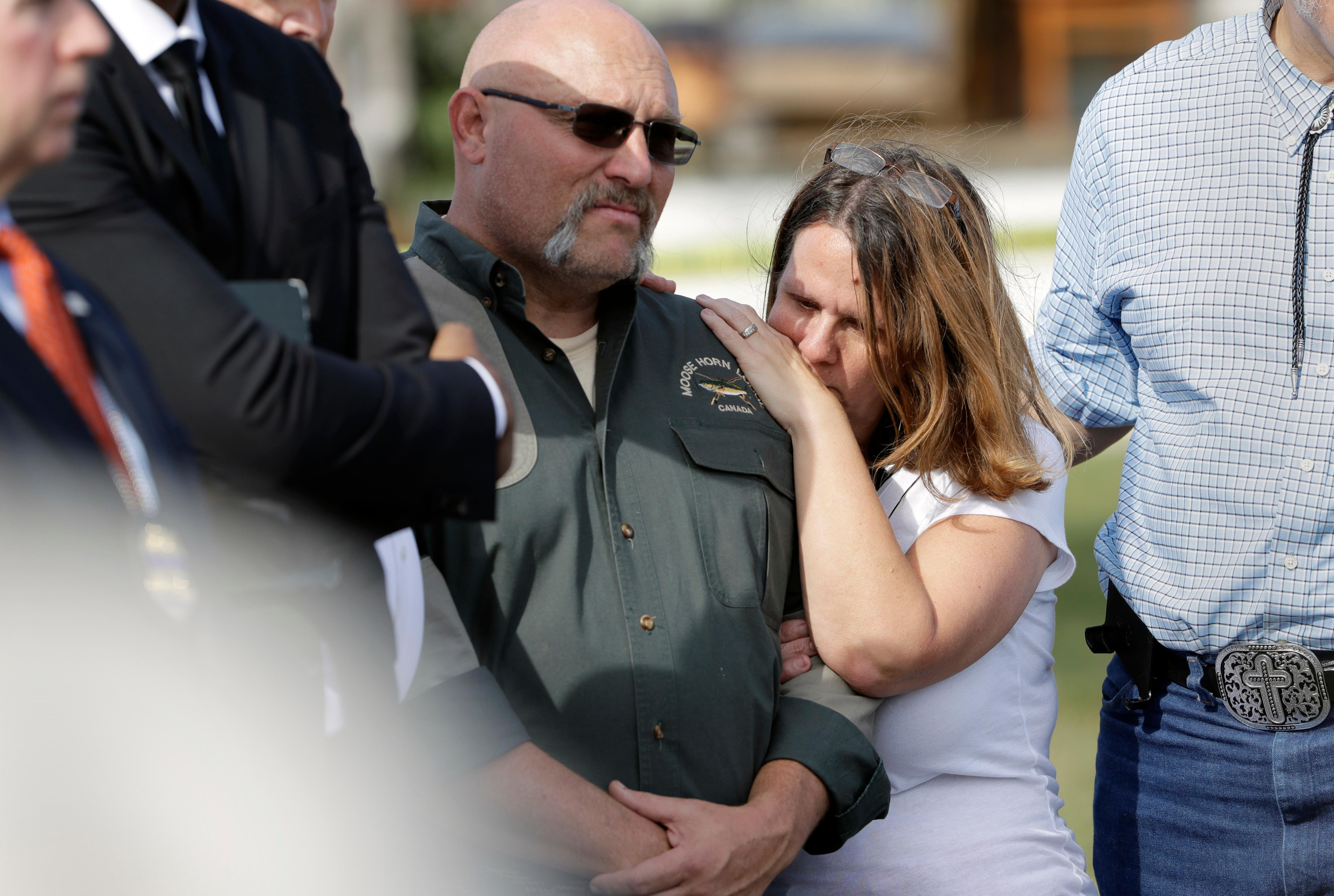 Pastor Frank Pomeroy and his wife Sherri join a news conference near the First Baptist Church of Sutherland Springs, Monday, Nov. 6, 2017, in Sutherland Springs, Texas. A man opened fire inside the church in the small South Texas community on Sunday, killing and wounding many. The Pomeroys daugher, Annabelle, 14, was killed in the shooting. (AP Photo/Eric Gay)