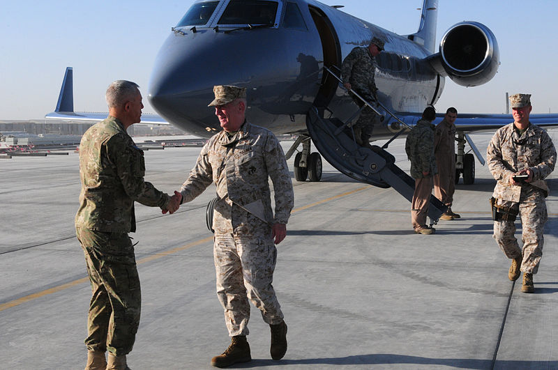 Maj. Gen. Jim Huggins (left) of the 82nd Airborne Division greets and shakes hands with Marine Gen. James Mattis (right) of U.S. Central Command right after Mattis stepped of his plane on Kandahar Airfield in Afghanistan in 2011. (photo credit: WikiCommons).