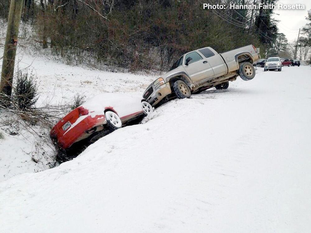 Two vehicles crashed into a ditch off Roper Road in Trussville, Tuesday, January 28, 2014.