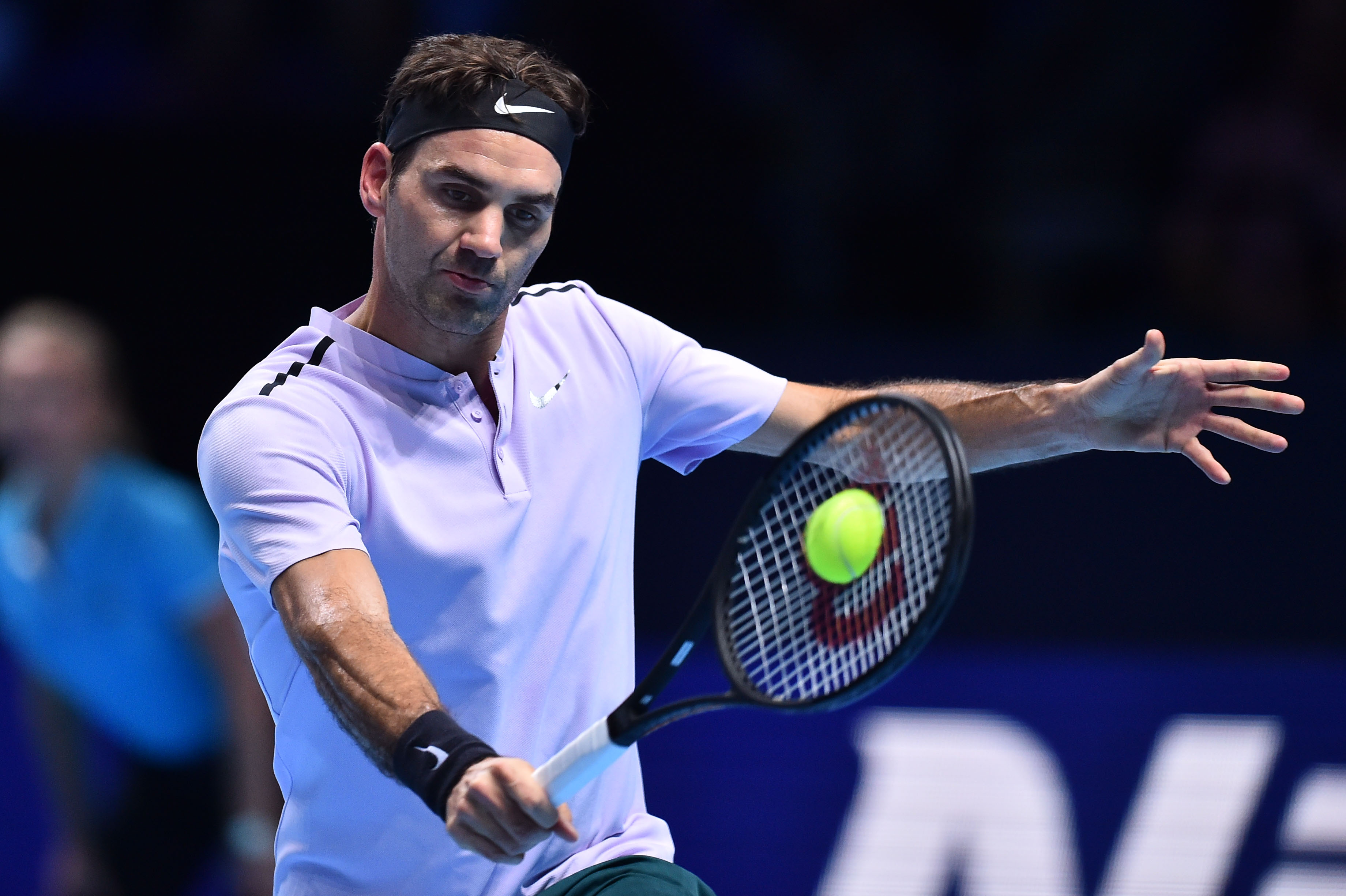 Switzerland's Roger Federer returns against Germany's Alexander Zverev during their men's singles round-robin match on day three of the ATP World Tour Finals tennis tournament at the O2 Arena in London on November 14, 2017. / AFP PHOTO / Glyn KIRK        (Photo credit should read GLYN KIRK/AFP/Getty Images)