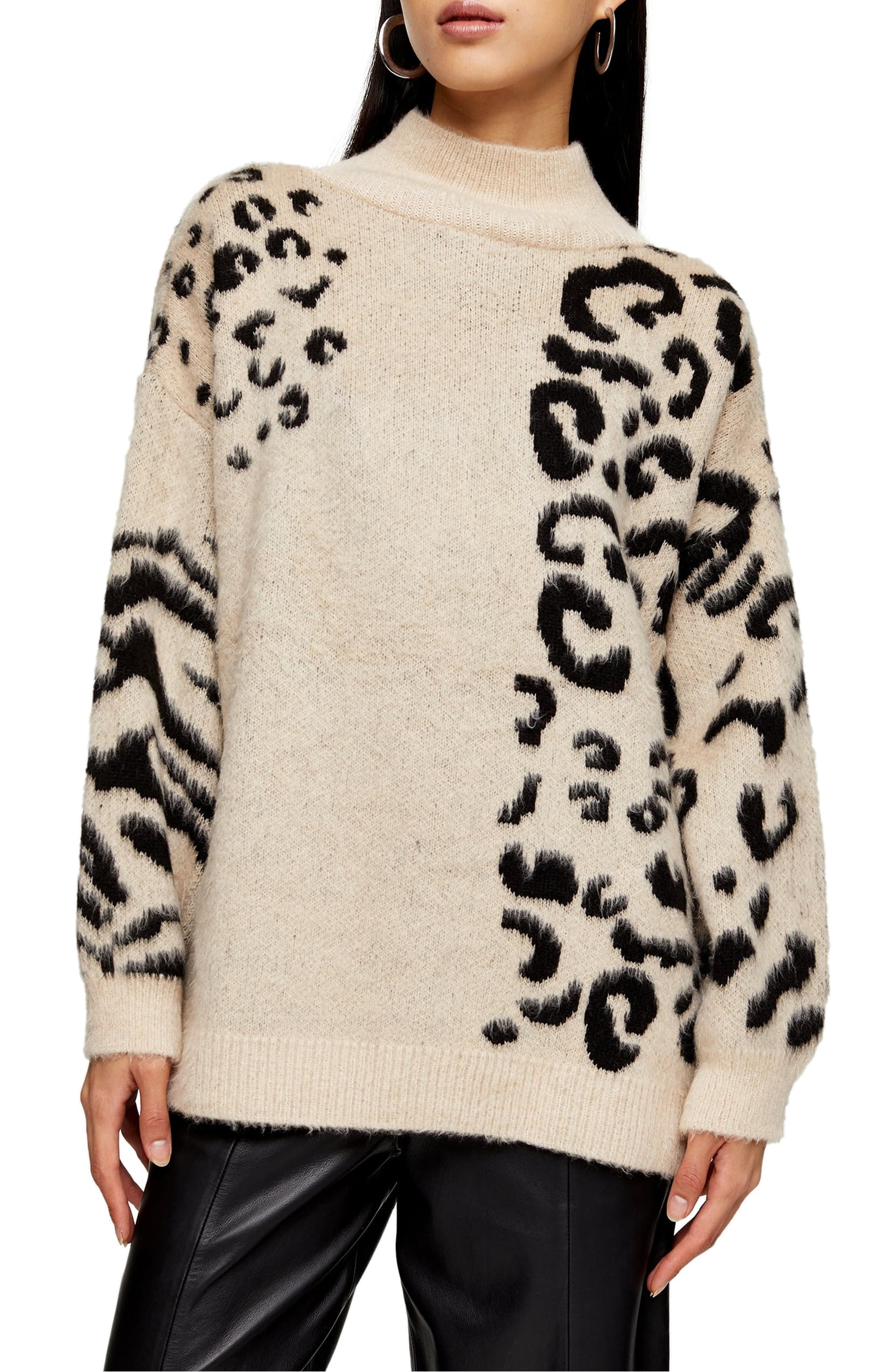 Fulfill all your cozy style needs with this mock-neck sweater covered in an eclectic mix of animal patterns. Shop it{ }- $75. (Image: Nordstrom){ }