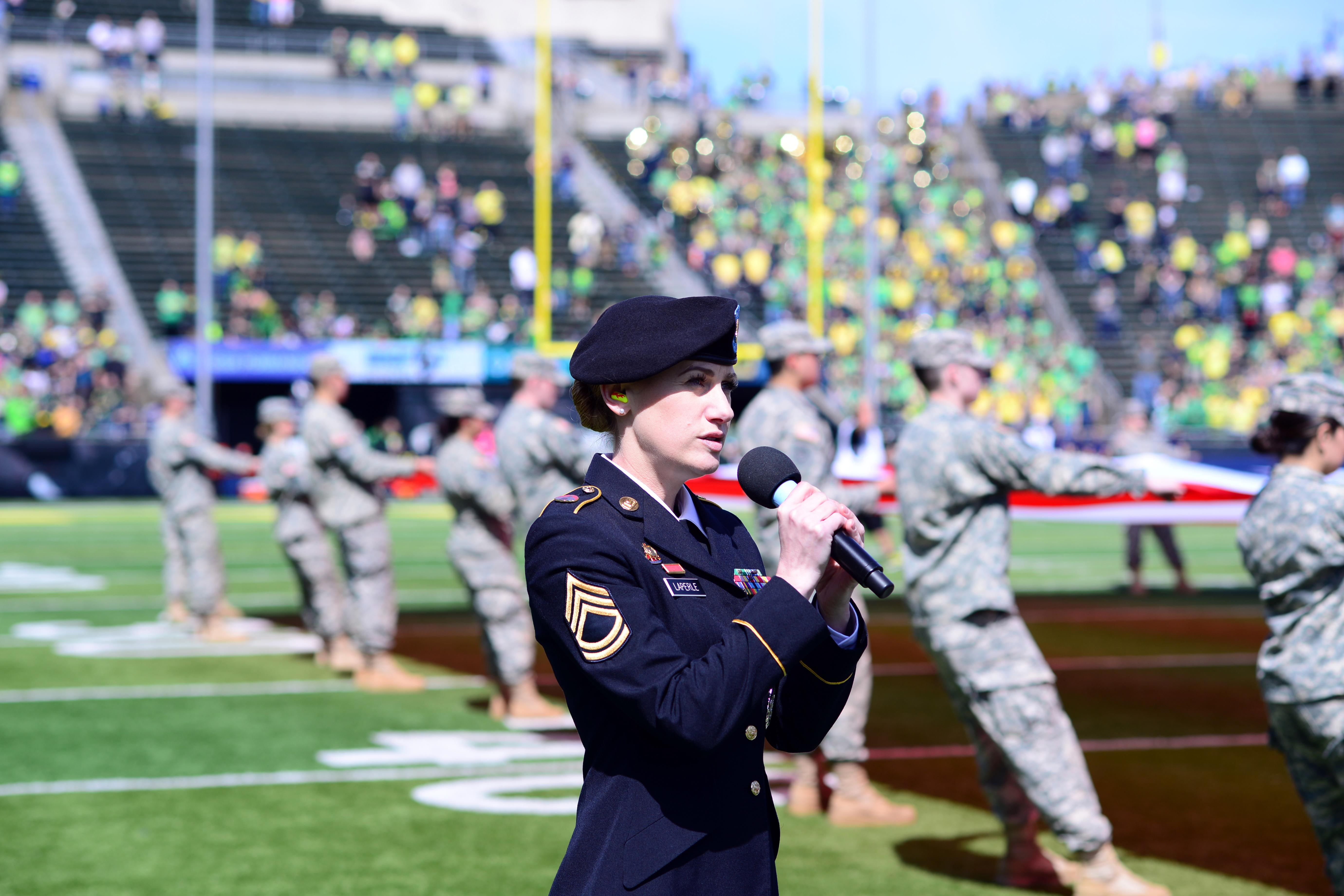 Oregon Army National Guard Sgt. 1st Class Amber LaPerle sings the National Anthem to begin the University of Oregon's Spring Game, April 29, 2017, in Eugene, Oregon. Veterans from every branch of service participated in Military Appreciation Day activities during the game. (Photo by Sgt. 1st Class April Davis, Oregon Military Department Public Affairs)