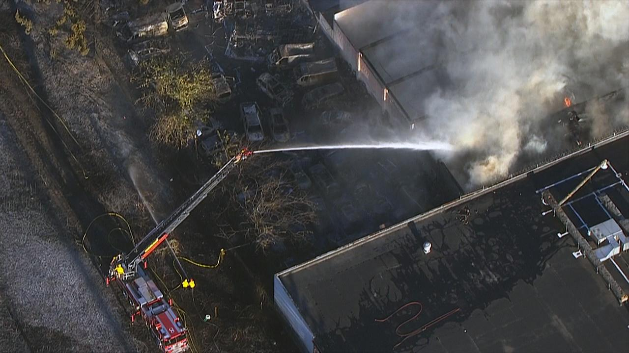 Firefighters work to put out a fast-moving brush fire in Northeast Portland Monday, Aug. 26, 2019 that spread to several buildings. (Photo: Chopper 2/KATU News)