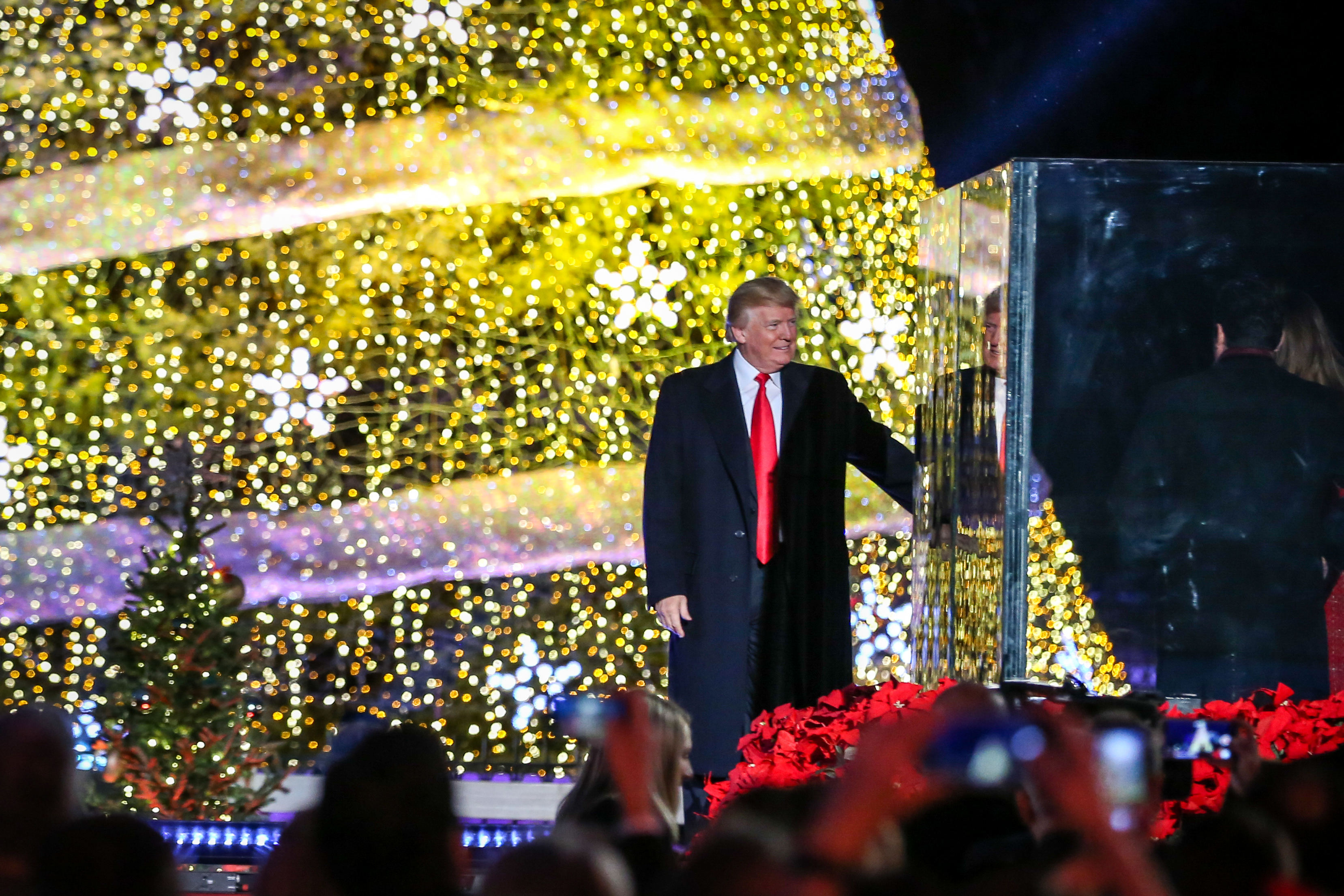 President Trump and First Lady Melania illuminated the 95th National Christmas Tree in front of the White House on Nov. 30. On the campaign trail, President Trump had criticized the use of 'happy holidays' instead of 'merry Christmas', and his remarks last night focused on the religious origins of the holiday. The lineup was perhaps slightly less A-list than Obama's tree lighting ceremony last year, but nevertheless President Trump could be seen swaying to the tunes of the Beach Boys, Jack Wagner and  Wynonna Judd. The special will air on Monday on the Hallmark Channel. (Amanda Andrade-Rhoades/DC Refined)