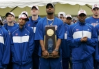In this April 8, 2008, file photo, Kansas's Darnell Jackson holds the championship trophy as other members of the basketball team watch a video during a rally at Kansas Memorial Stadium in Lawrence, Kansas.